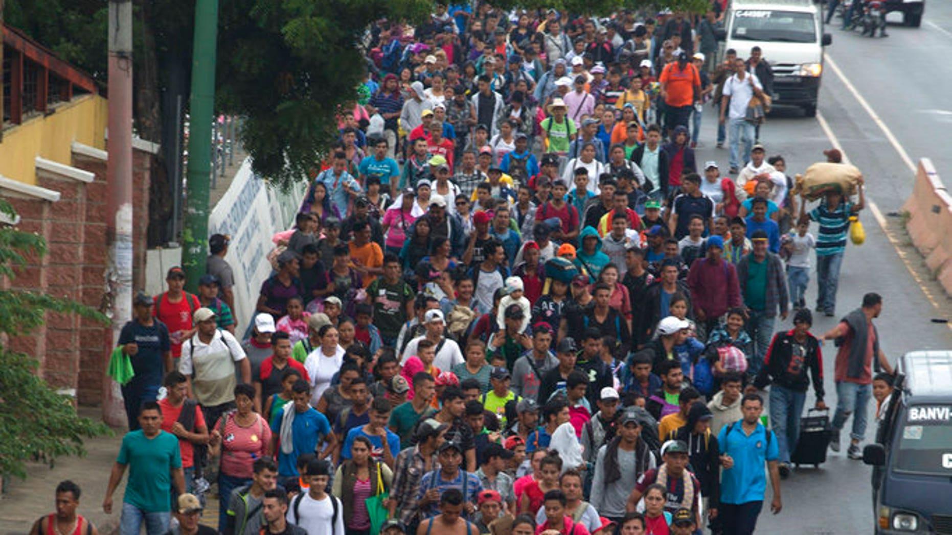 Honduran migrants walking to the U.S. start their day departing Chiquimula, Guatemala. (AP Photo/Moises Castillo)