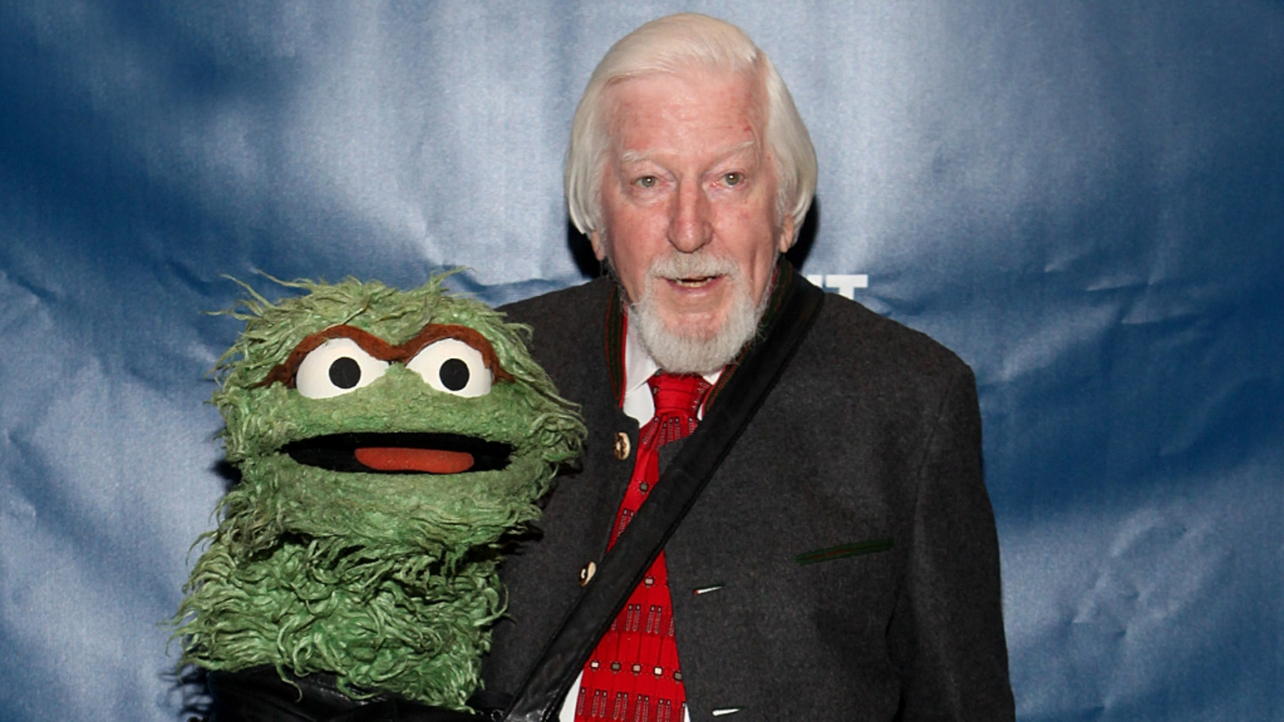 """Caroll Spinney told The New York Times he was retiring from """"Sesame Street"""" after portraying Big Bird and Oscar the Grouch since 1969."""
