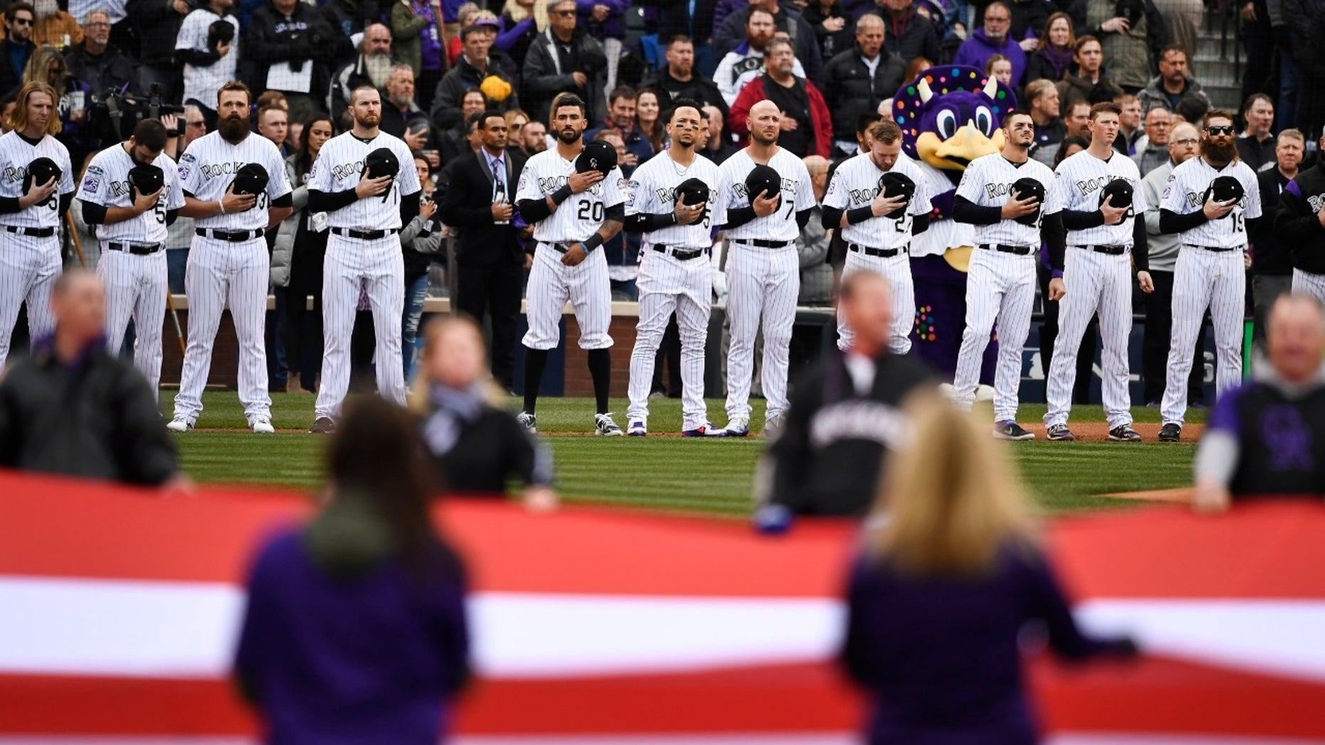 The Colorado Rockies seen here lining up before the national anthem.