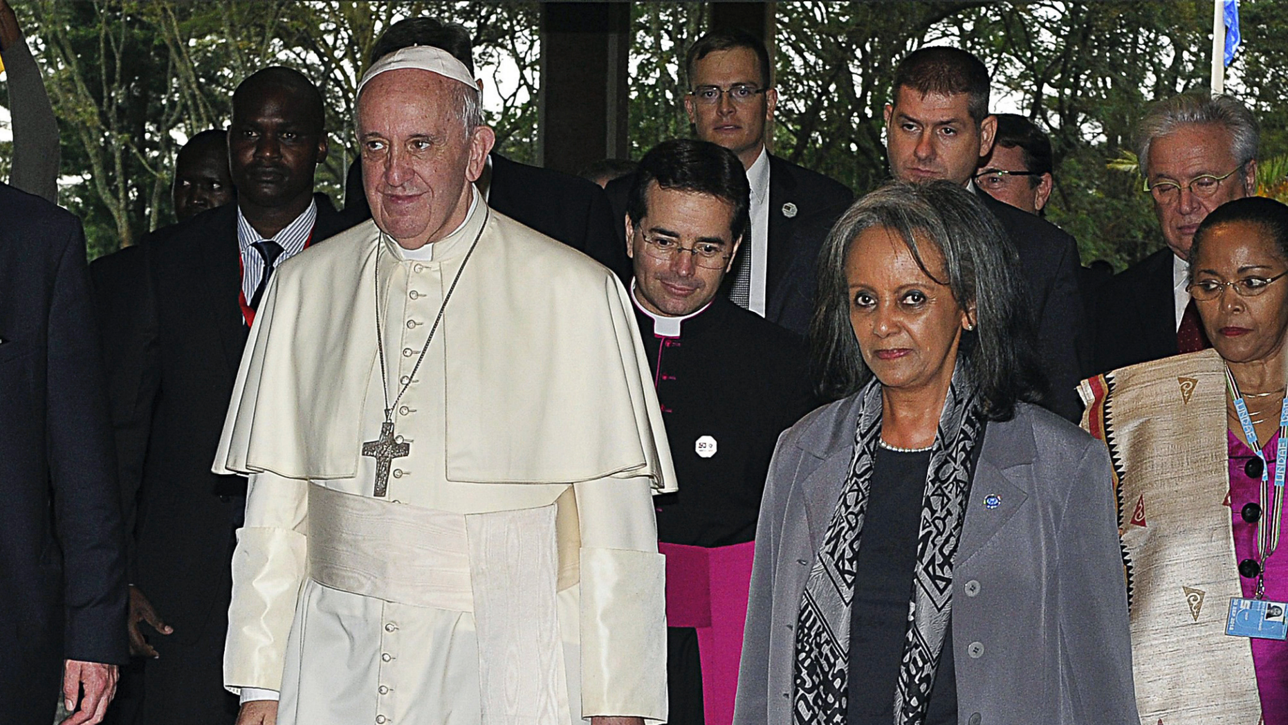 FILE - In this Thursday, Nov. 26, 2015 file photo, Pope Francis walks next to then Director-General of the United Nations Office at Nairobi (UNON) Sahle-Work Zewde, right, upon his arrival there in Nairobi, Kenya. Ethiopian lawmakers unanimously elected the seasoned diplomat Sahle-Work Zewde as the country's first female president, a largely ceremonial post, on Thursday, Oct. 25, 2018. (Simon Maina/Pool via AP, File)