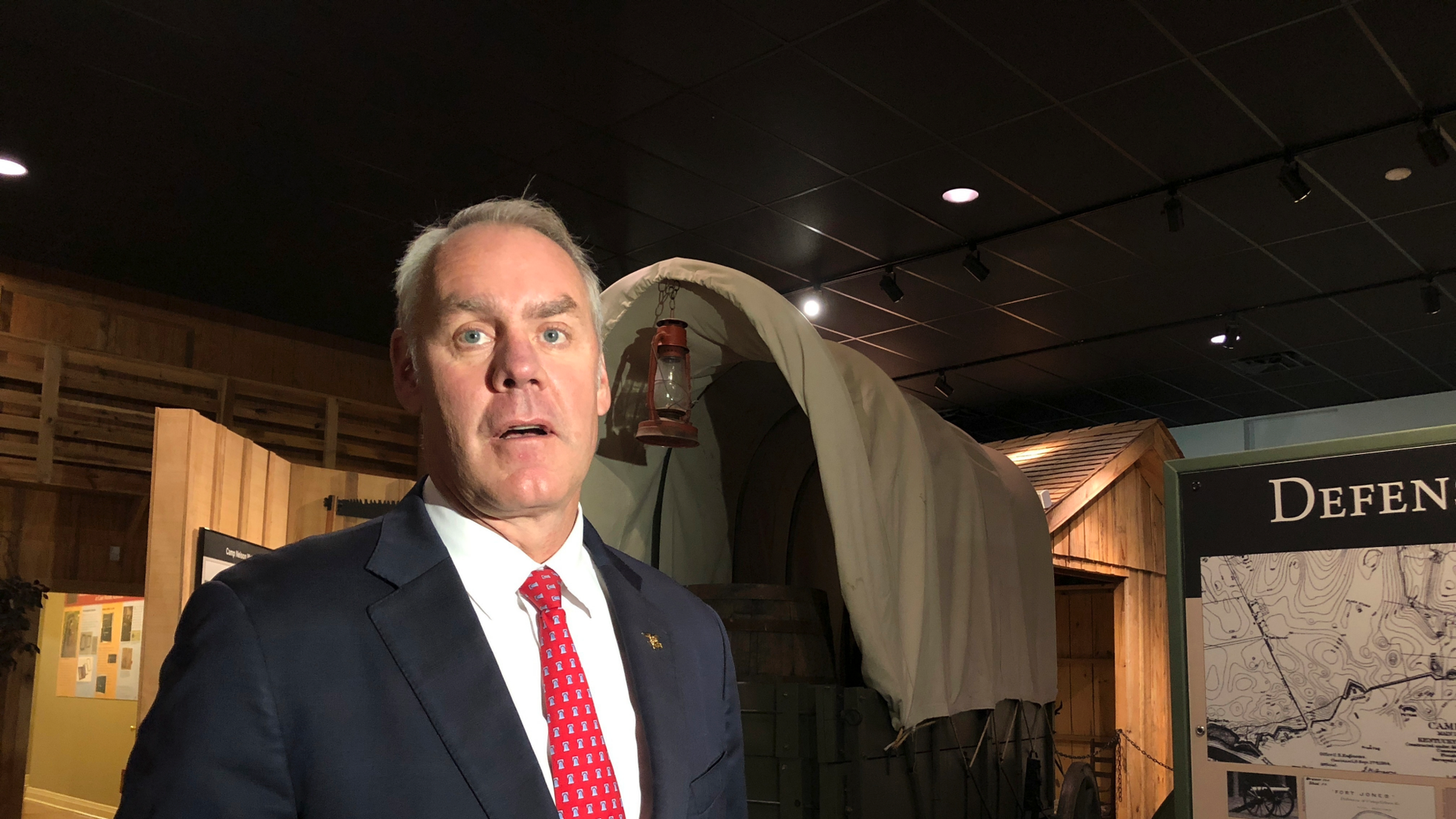 U.S. Interior Secretary Ryan Zinke speaks with reporters at the Camp Nelson National Monument on Saturday, Oct. 27, 2018, in Nicholasville, Kentucky. Camp Nelson was a Union Army depot during the U.S. Civil War and was a recruiting center for black soldiers. Zinke announced Saturday Camp Nelson has been officially designated as a national monument.  (AP Photo/Adam Beam)