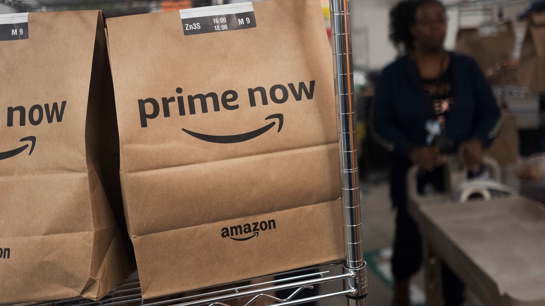 FILE- In this Dec. 20, 2017, file photo, Prime Now customer orders are ready for delivery at the Amazon warehouse in New York. Same-day delivery promises the convenience of online ordering with nearly the same immediacy of store buying. (AP Photo/Mark Lennihan, File)