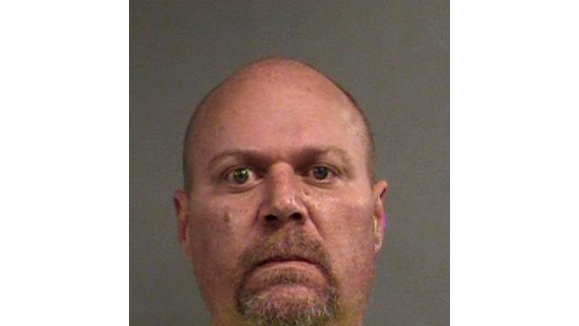 This photo provided by Louisville Metro Department of Corrections shows Gregory Alan Bush, who was booked early Thursday, Oct. 25, 2018, on two counts of murder and 10 counts of felony wanton endangerment, according to Louisville Metro Detention Center records. (Louisville Metro Department of Corrections via AP)