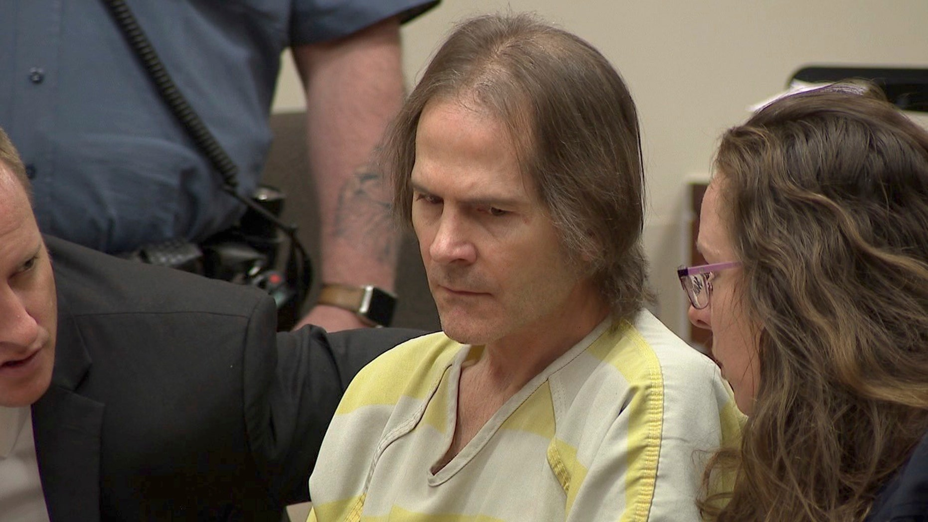 This image made from video shows Scott Ostrem in court in Brighton, Colo., Friday, Oct. 19. 2018. Ostrem, who gunned down three people in a suburban Denver Walmart on 2017, was sentenced Friday to life in prison without parole, but more than 11 months after the crime, his motive remains a mystery. (KMGH-TV via AP, Pool)