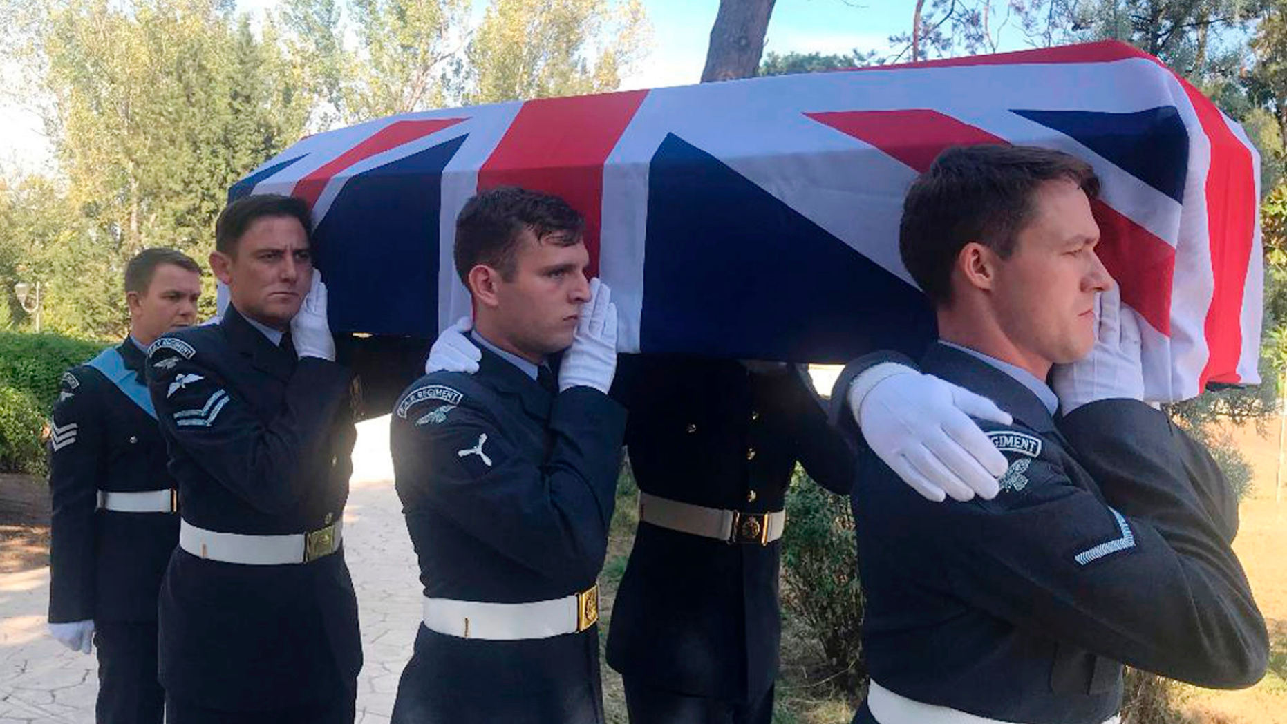 British soldiers carry a coffin of a British serviceman at the Grand Park in Tirana, Wednesday, Oct. 24, 2018, as seven British military personnel from a plane that crashed in Albania during World War II are laid to rest almost 75-years after their death.  It was Sgt. John Thompson's ring that was hidden from the then communist officials, that has enabled searchers to locate and identify his remains, and those of his fellow crew members, after they crashed into a mountainside in Biza, Albania, on Oct. 29, 1944, and they are finally interred during an official funeral ceremony Wednesday in the Albanian capital. (AP Photo/Llazar Semini)