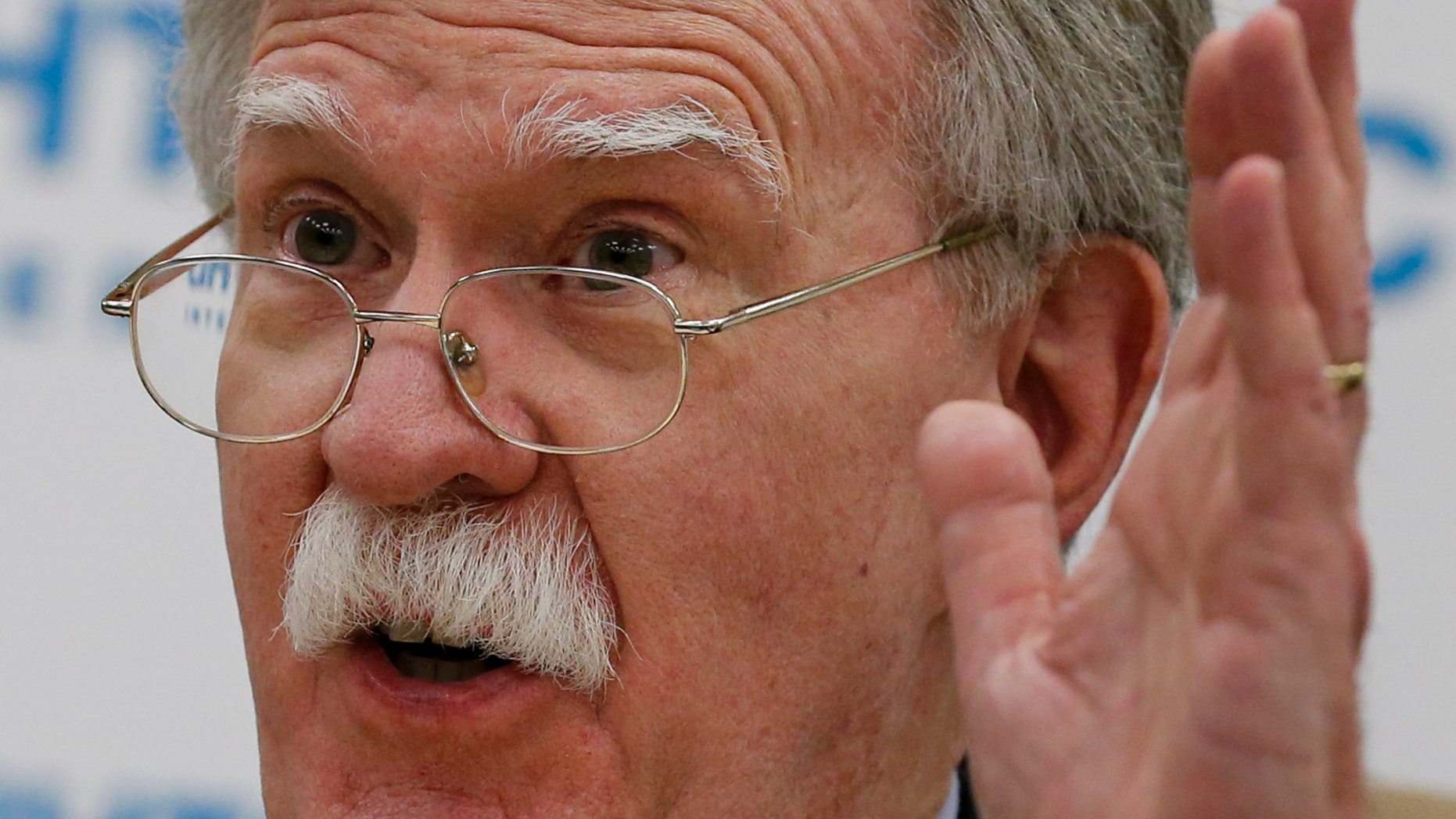 U.S. National security adviser John Bolton gestures as he speaks to the media after his talks with Russian President Vladimir Putin in Moscow, Russia, Tuesday, Oct. 23, 2018. Bolton said that Russia has hurt itself by meddling in the U.S. elections, effectively blocking the prospects for improving U.S.-Russia ties. (AP Photo/Alexander Zemlianichenko)