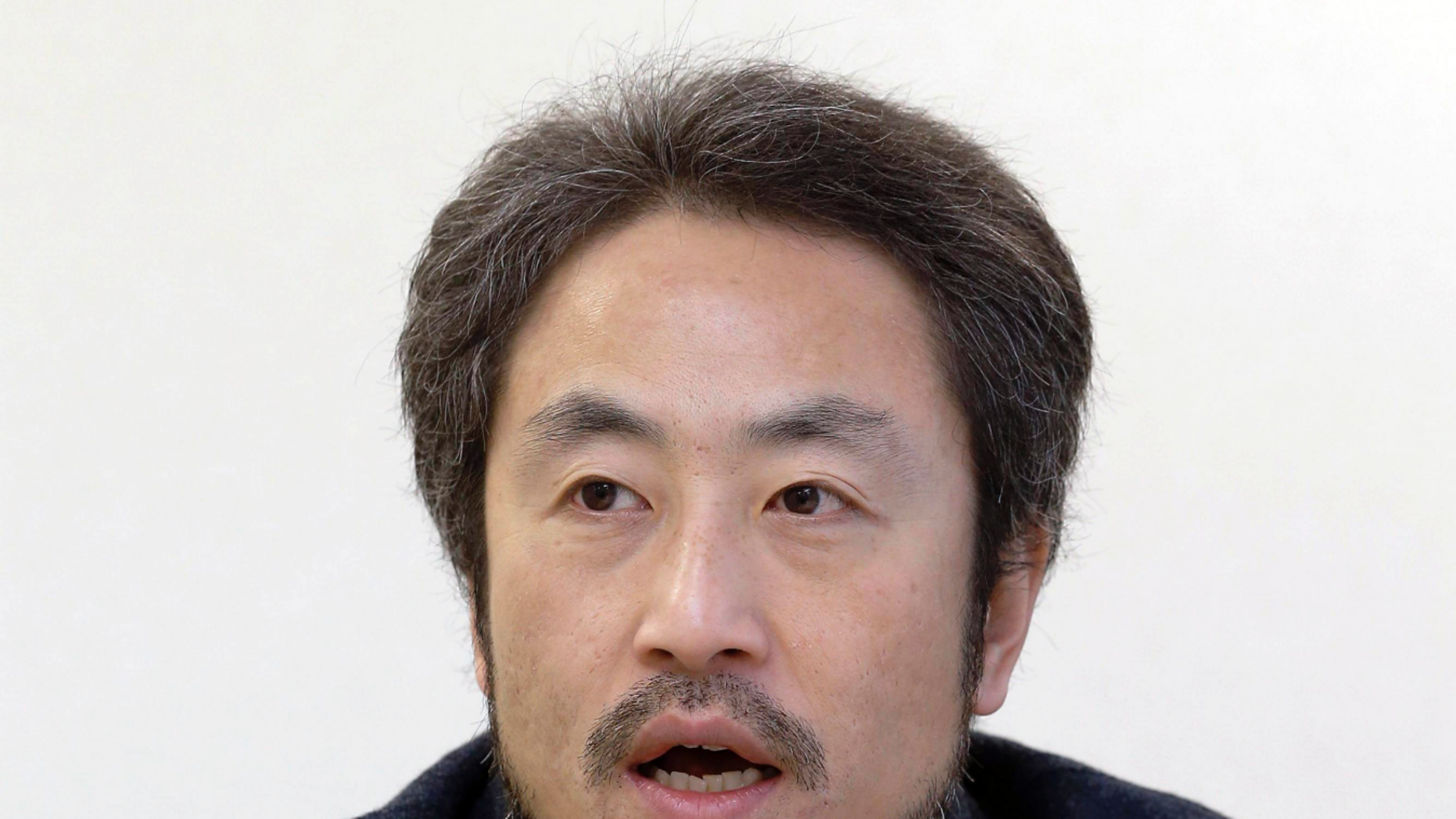 Jumpei Yasuda: Japanese journalist held hostage in Syria 'freed'