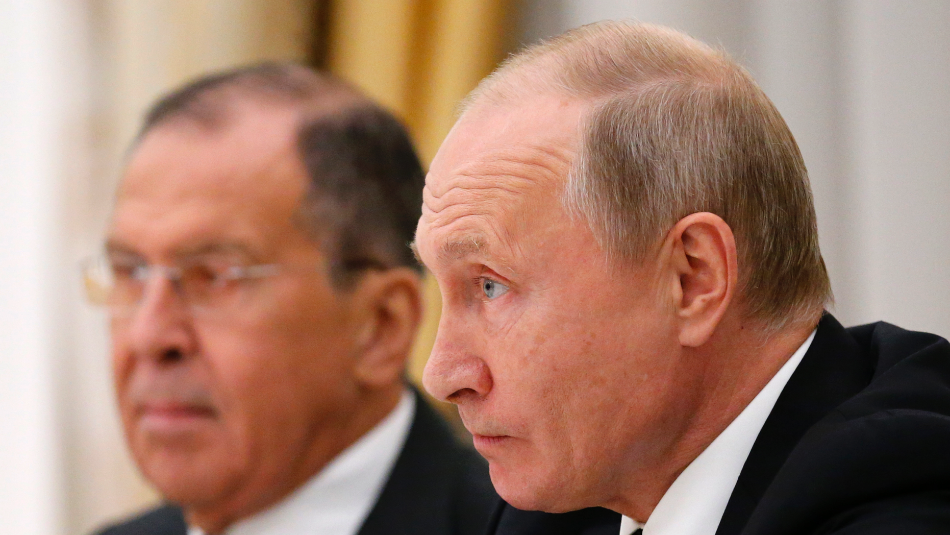 Russian President Vladimir Putin listens to U.S. National security adviser John Bolton during their meeting in the Kremlin in Moscow, Russia, Tuesday, Oct. 23, 2018, with Russian Foreign Minister Sergey Lavrov at left. (AP Photo/Alexander Zemlianichenko)