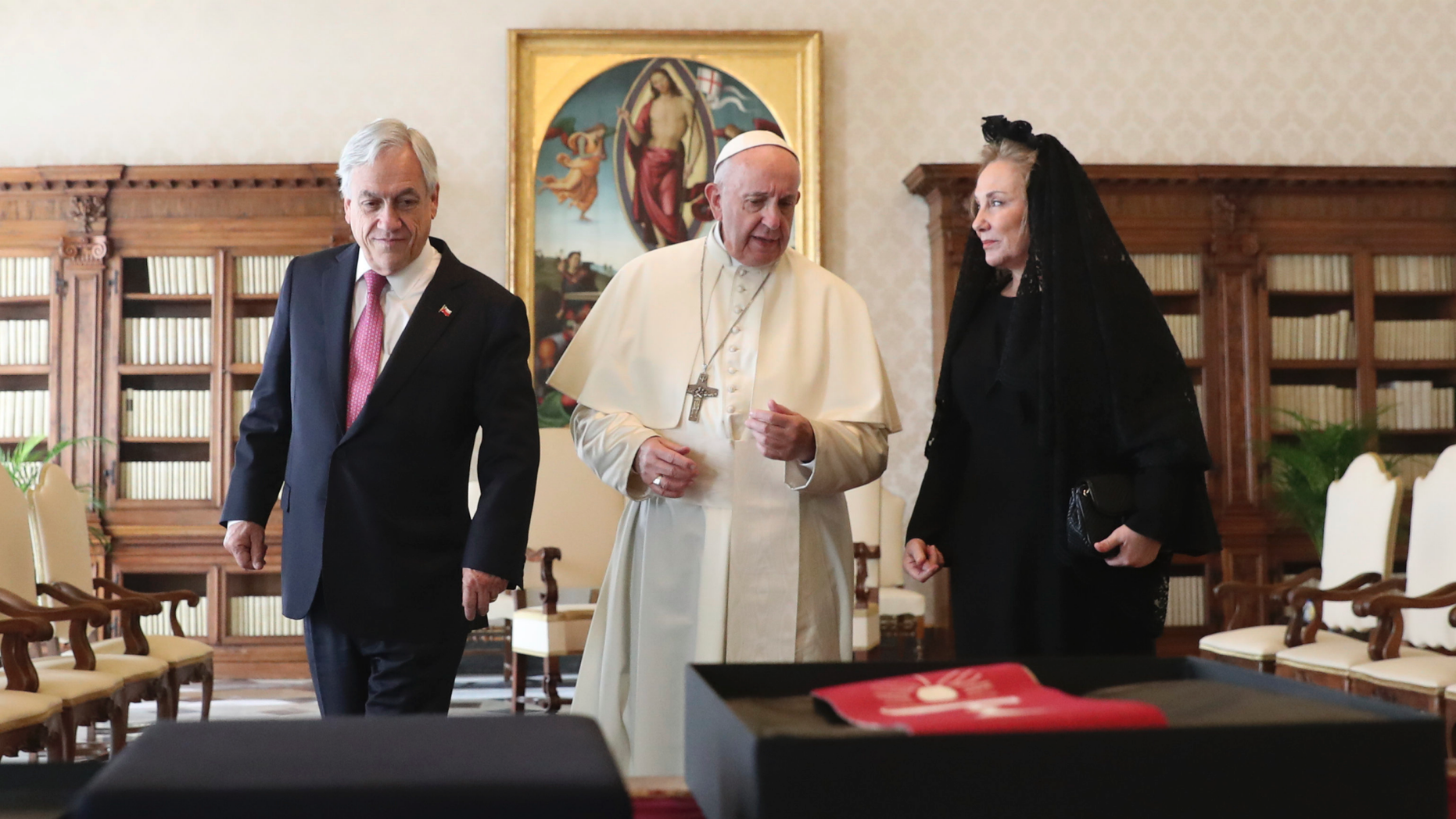 Pope Francis speaks as he meets with Chile's President Sebastian Pinera and his wife Cecilia Morel during a private audience at the Vatican, Saturday, Oct. 13, 2018. (Alessandro Bianchi/Pool Photo via AP)