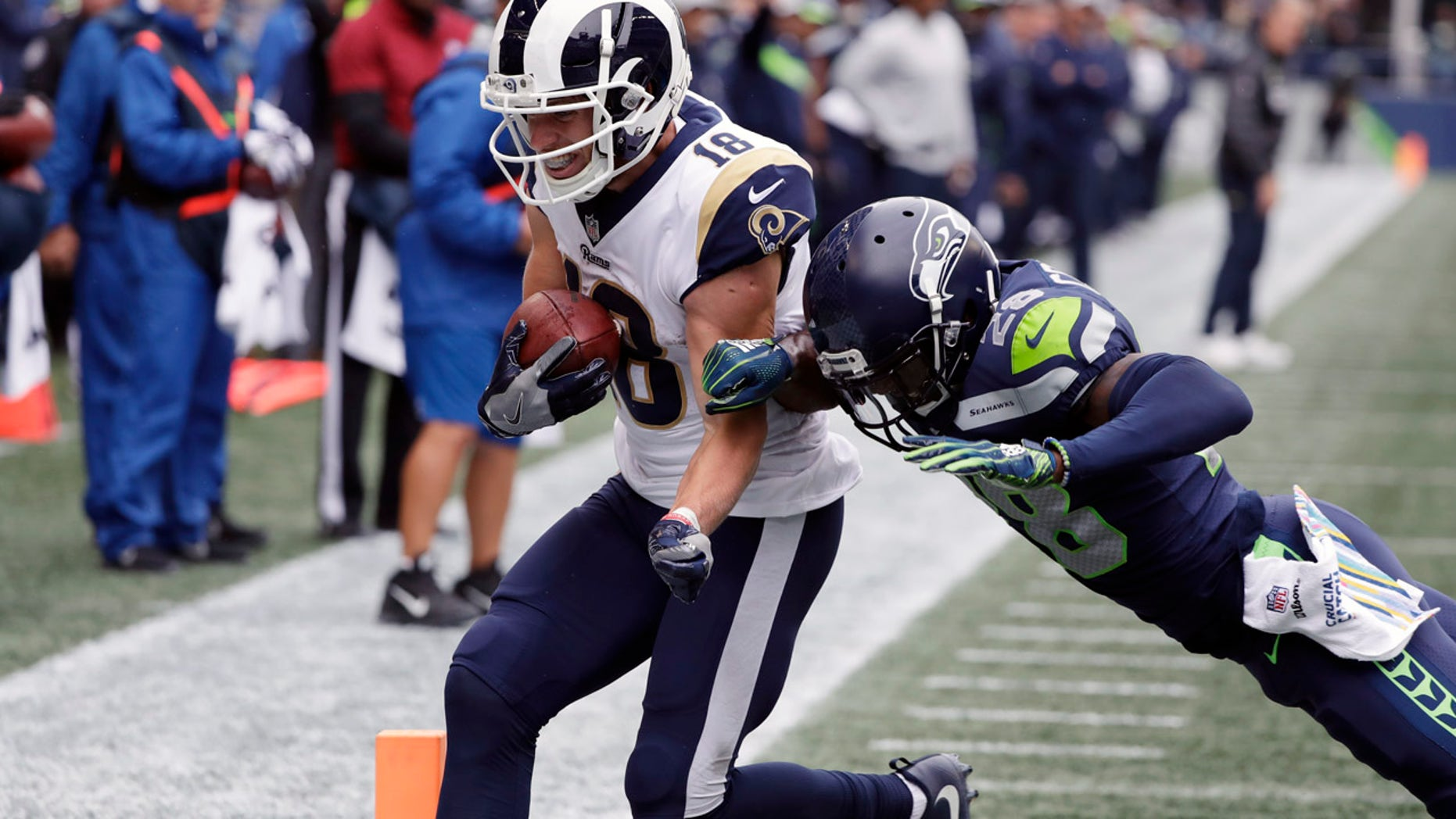 Los Angeles Rams wide receiver Cooper Kupp (18), seen here in last week's game, was carted off the field after a tackle Sunday.