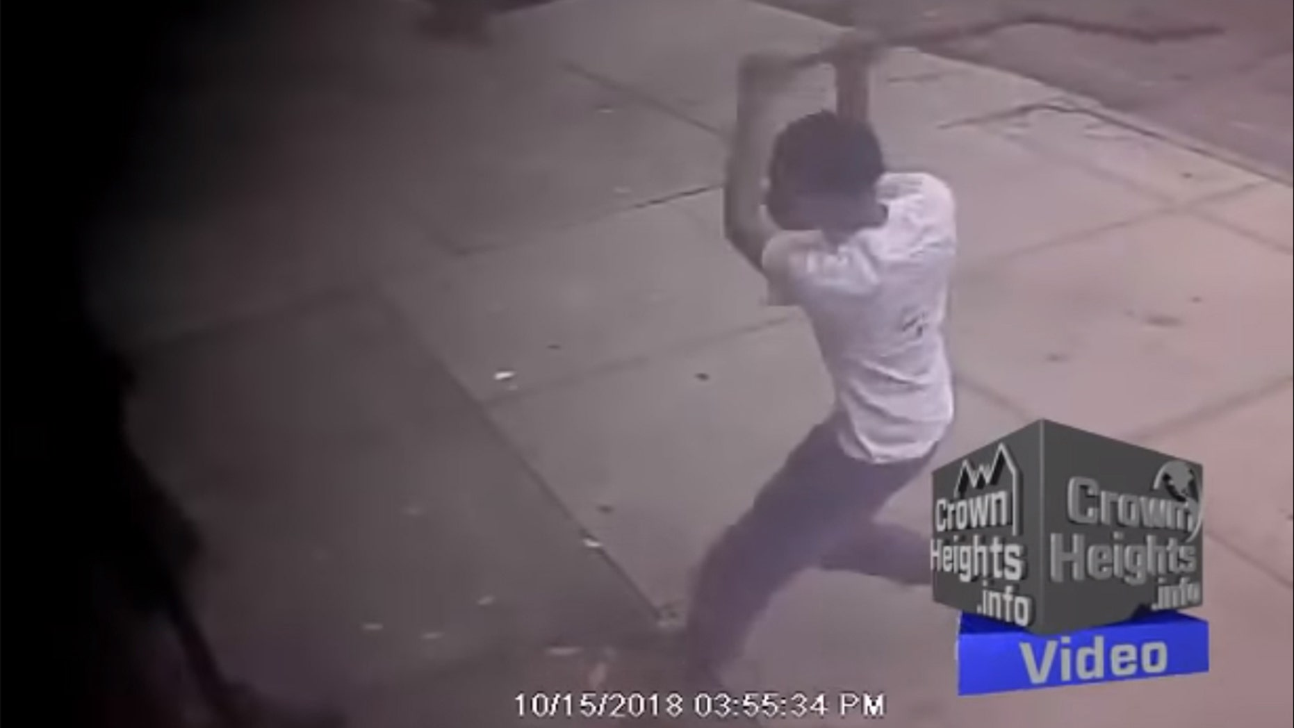 This surveillance photo shows an unidentified teenager attacking a Jewish man in a Brooklyn neighborhood.
