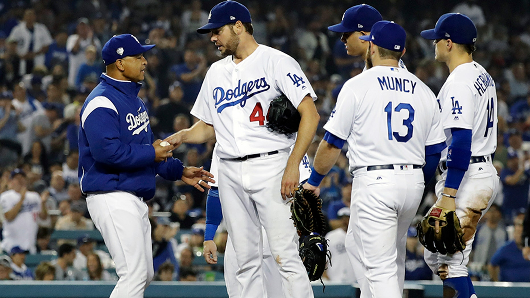 Los Angeles Dodgers pitcher Rich Hill is relieved by Los Angeles Dodgers manager Dave Roberts during the seventh inning in Game 4 of the World Series baseball game on Saturday, Oct. 27, 2018, in Los Angeles. (AP Photo/David J. Phillip)