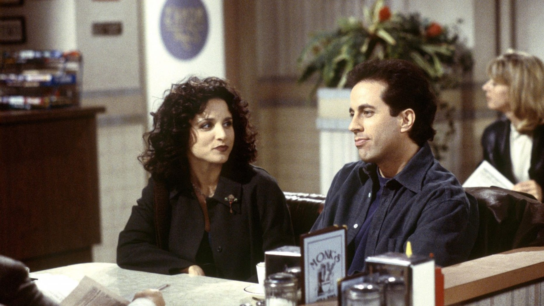 Julia Louis-Dreyfus, left, as Elaine Benes and Jerry Seinfeld, right,as himself on Seinfeld.