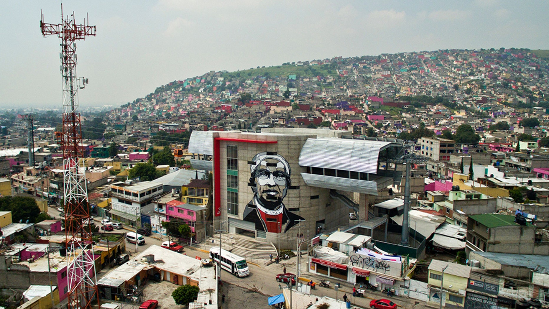 View of a cable car station decorated with a mural of Icelandic artist Guido Van Helten at a poor neighborhood in Ecatepec, Mexico on August 25, 2016.
