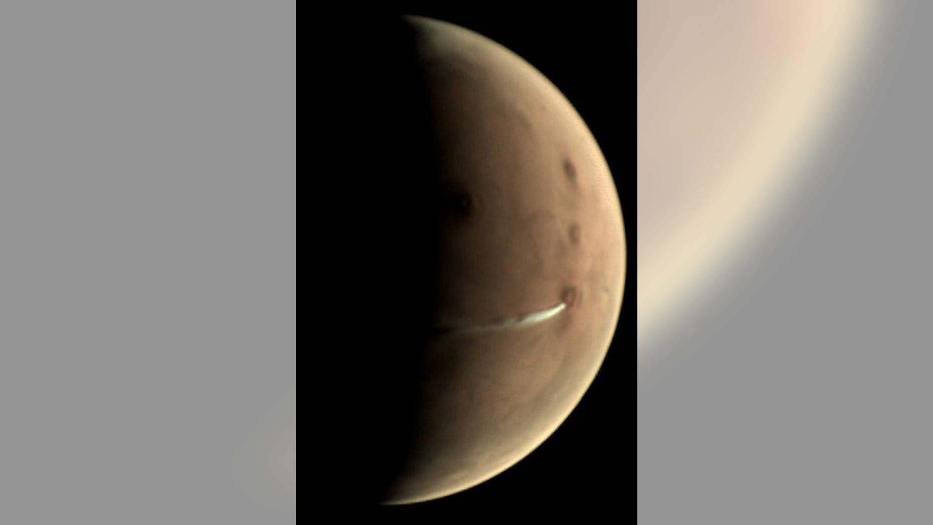 Since 13 September 2018, the Visual Monitoring Camera (VMC) on board ESA's Mars Express has been observing the evolution of a curious cloud formation that appears regularly in the vicinity of the 20 km-high Arsia Mons volcano, close to the planet's equator. (Credit: ESA/GCP/UPV/EHU Bilbao, CC BY-SA 3.0 IGO)