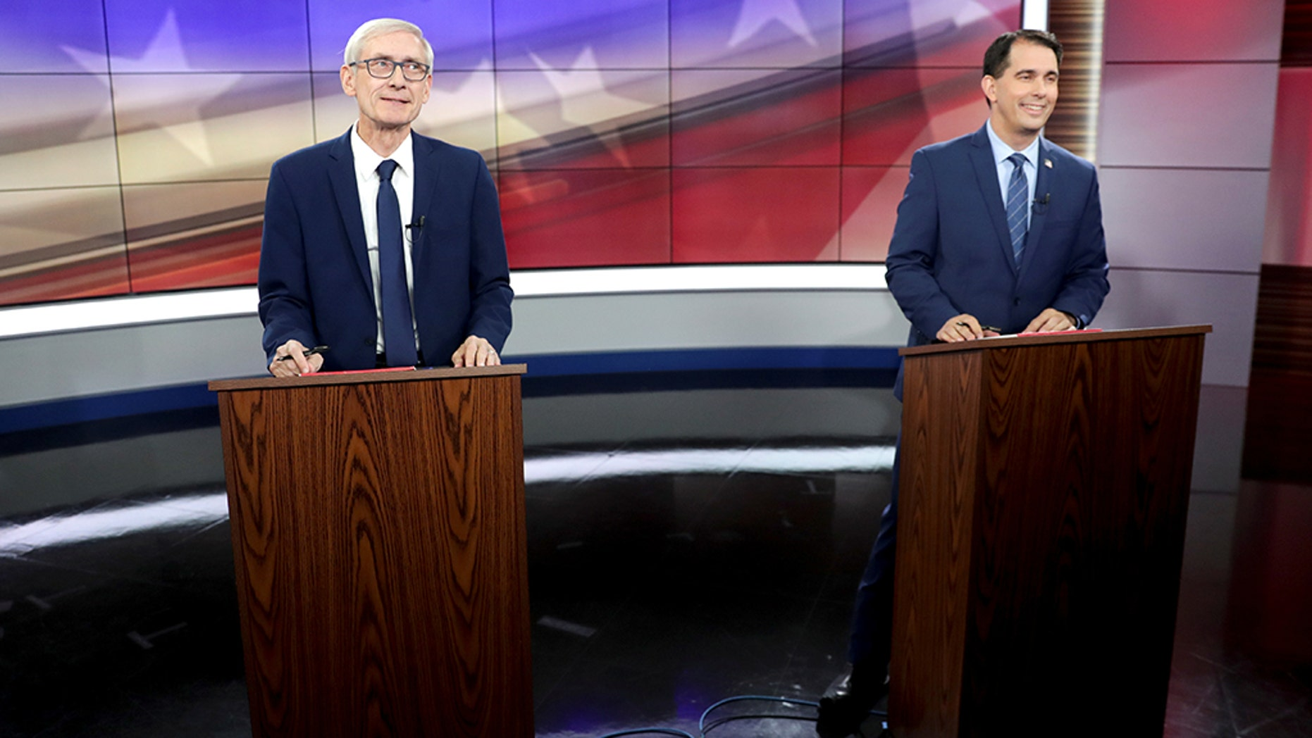 Democratic challenger Tony Evers (L) and Wisconsin Gov. Scott Walker (R). (Steve Apps/Wisconsin State Journal/Pool via REUTERS)