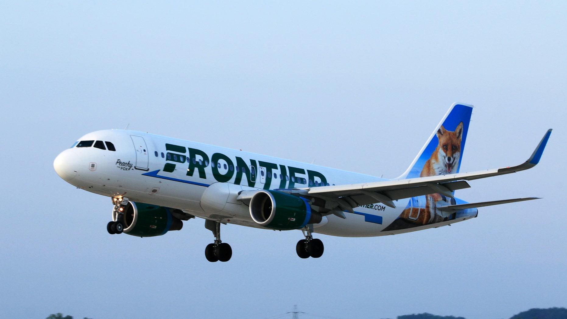 Frontier Airlines passenger opens cabin door on plane images