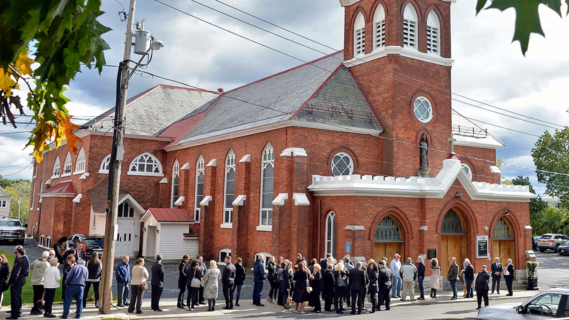 """Mourners enter St. Stanislaus Roman Catholic Church to attend calling hours for Schoharie limo crash victims; Abigail (King) Jackson, Adam """"Action"""" Jackson, Mary (King) Dyson, Robert J. Dyson, Allison A. King, Amy (King) Steenburg, Axel J. Steenburg and Richard Steenburg Jr., on Friday Oct. 12, 2018, in Amsterdam, N.Y. (John Carl D'Annibale/The Albany Times Union via AP)"""