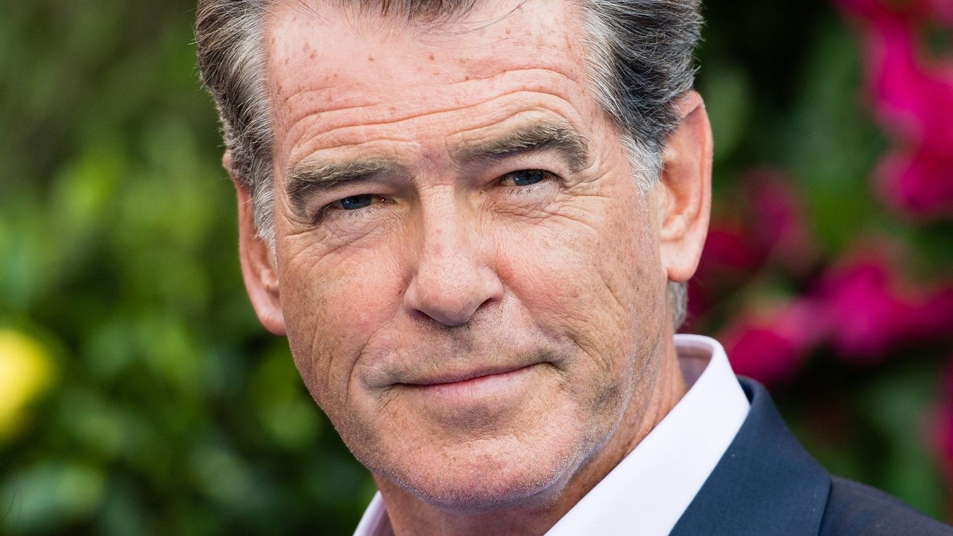 Pierce Brosnan said he had a close encounter with a shark during his vacation in French Polynesia.