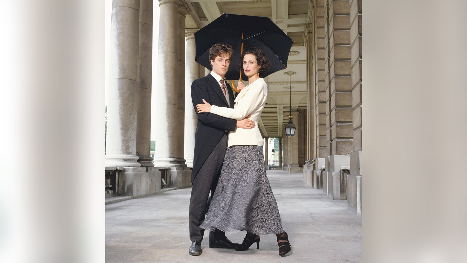Actor Hugh Grant and actress Andie MacDowell posing as their characters from Richard Curtis' 1994 comedy 'Four Weddings And A Funeral.""