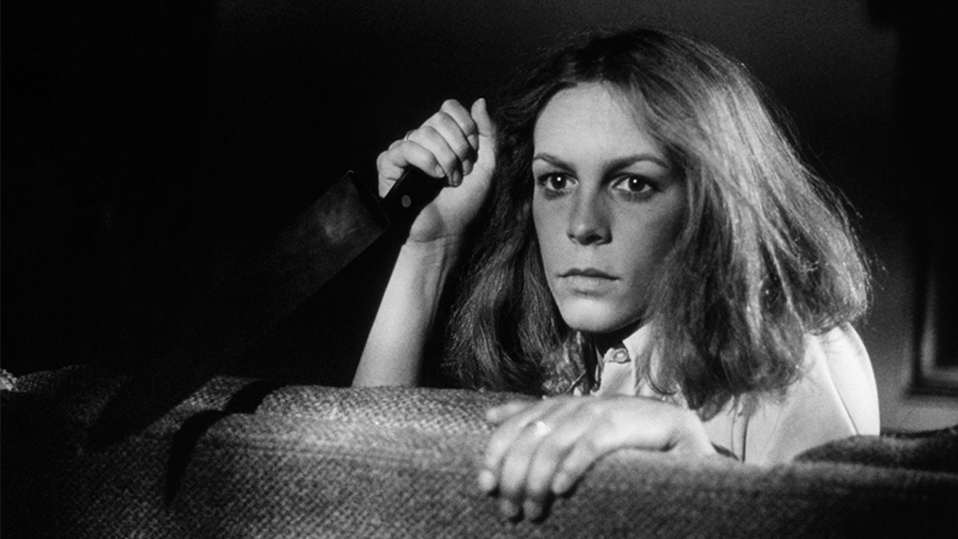 """Jamie Lee Curtis on the set of """"Halloween,"""" written and directed by John Carpenter."""