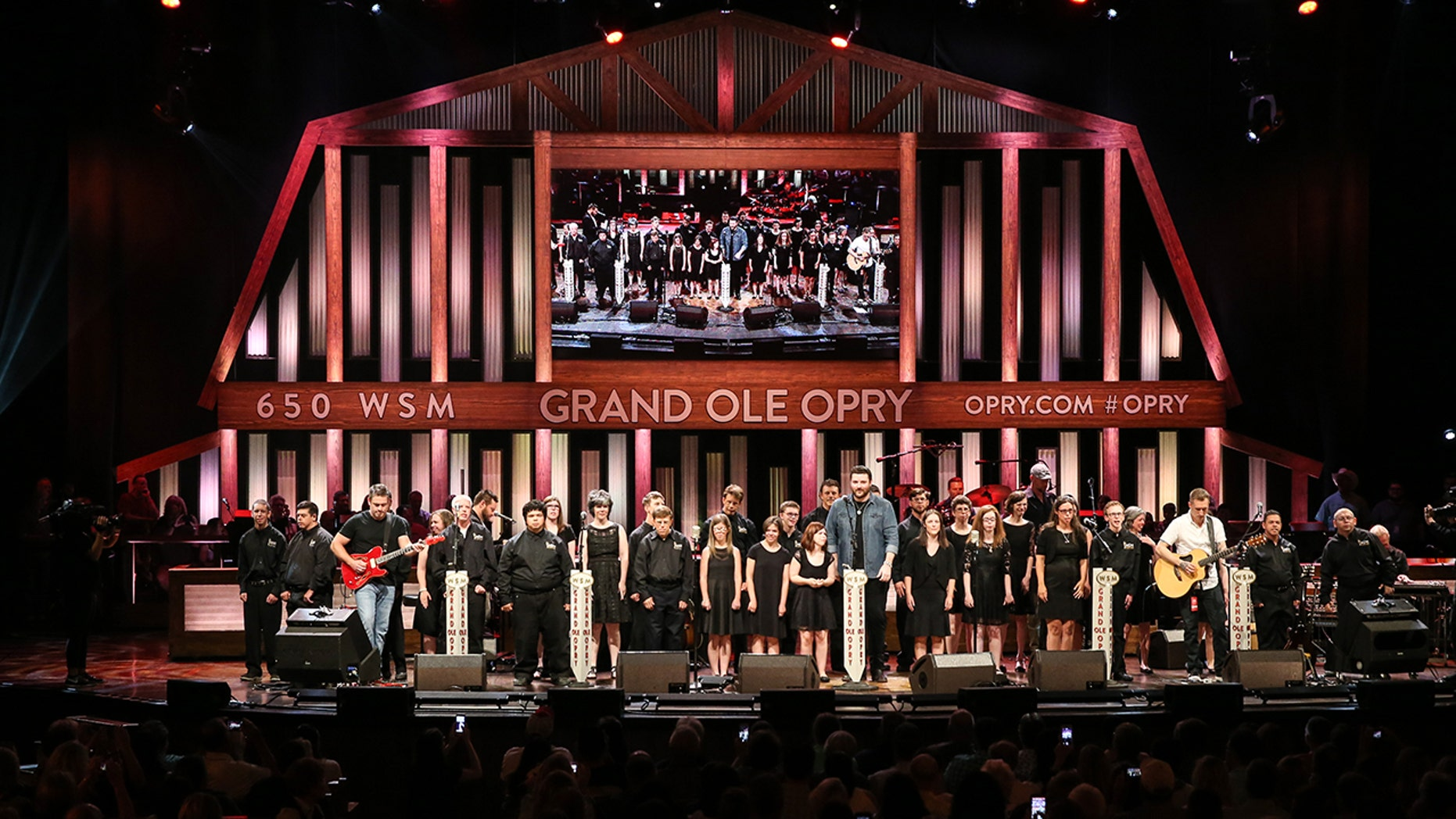 The Grand Ole Opry will help raise money for a fan battling cancer. Pictured is the ACM Lifting Lives music Campers joining Singer-songwriter Chris Young on stage during a Performance at Grand Ole Opry House on June 27, 2017 in Nashville, Tennessee.