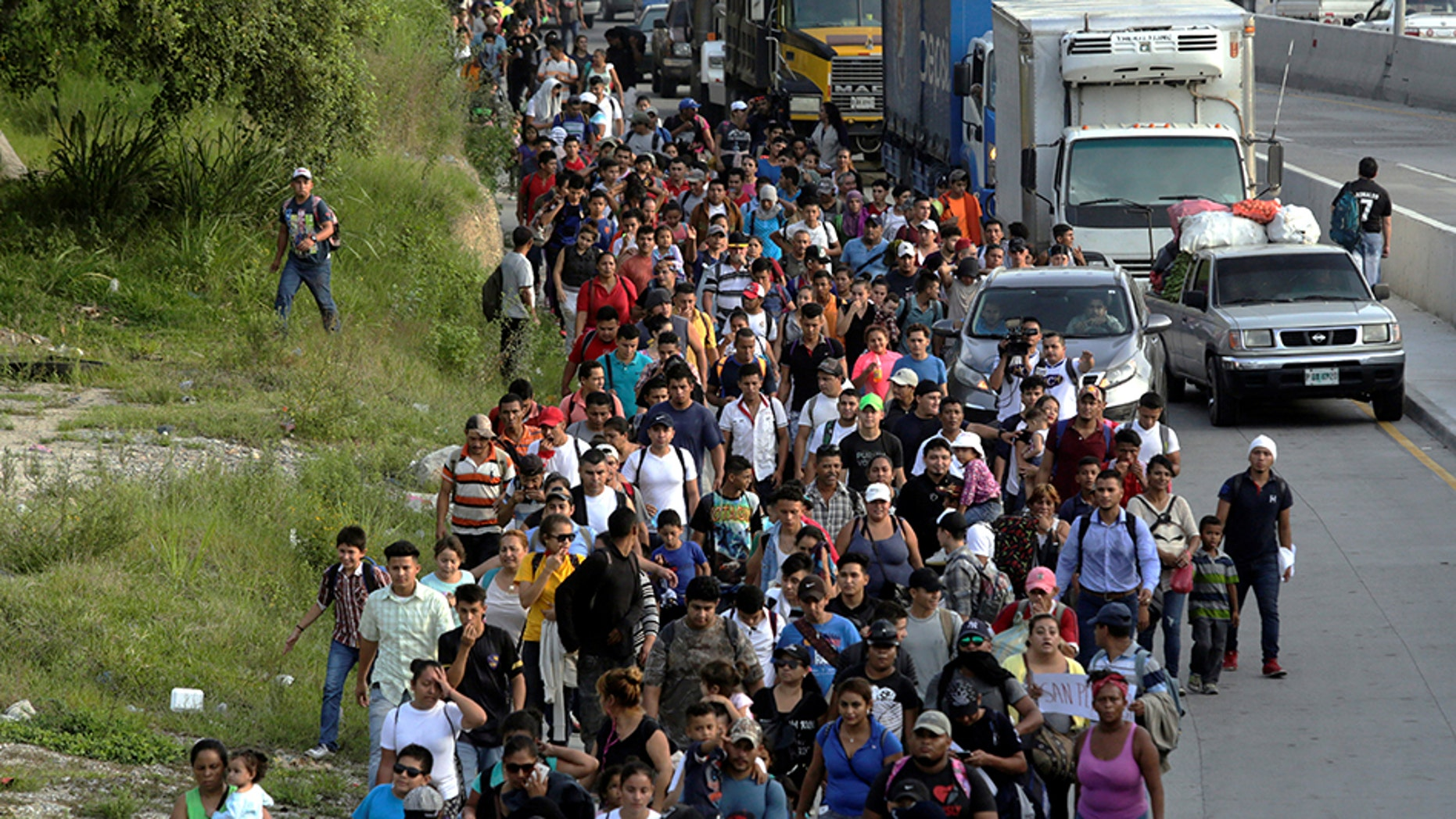 Hondurans fleeing poverty and violence are seen here in San Pedro Sula. They're headed toward the U.S