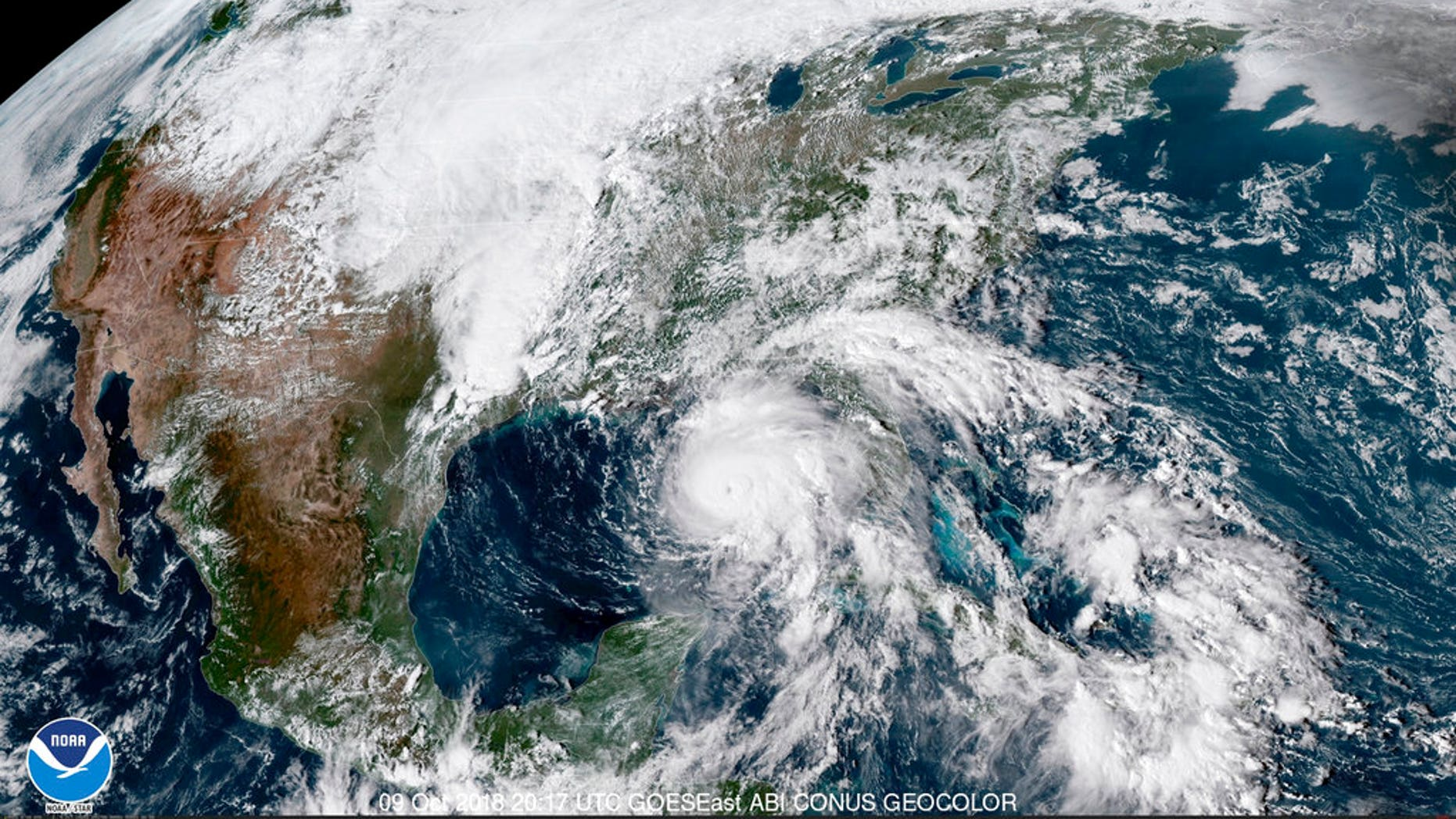 This satellite image made available by NOAA shows Hurricane Michael, center, in the Gulf of Mexico. (NOAA via AP)