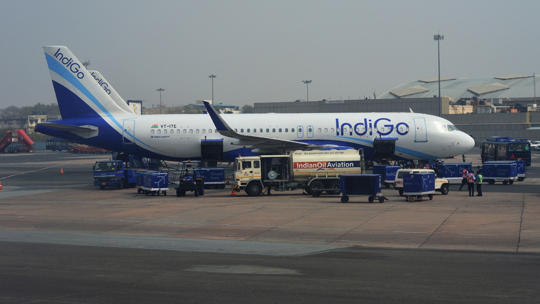 The IndiGo passenger is accused of pressing against the flight attendant's back, and then verbally abusing her when she confronted him.