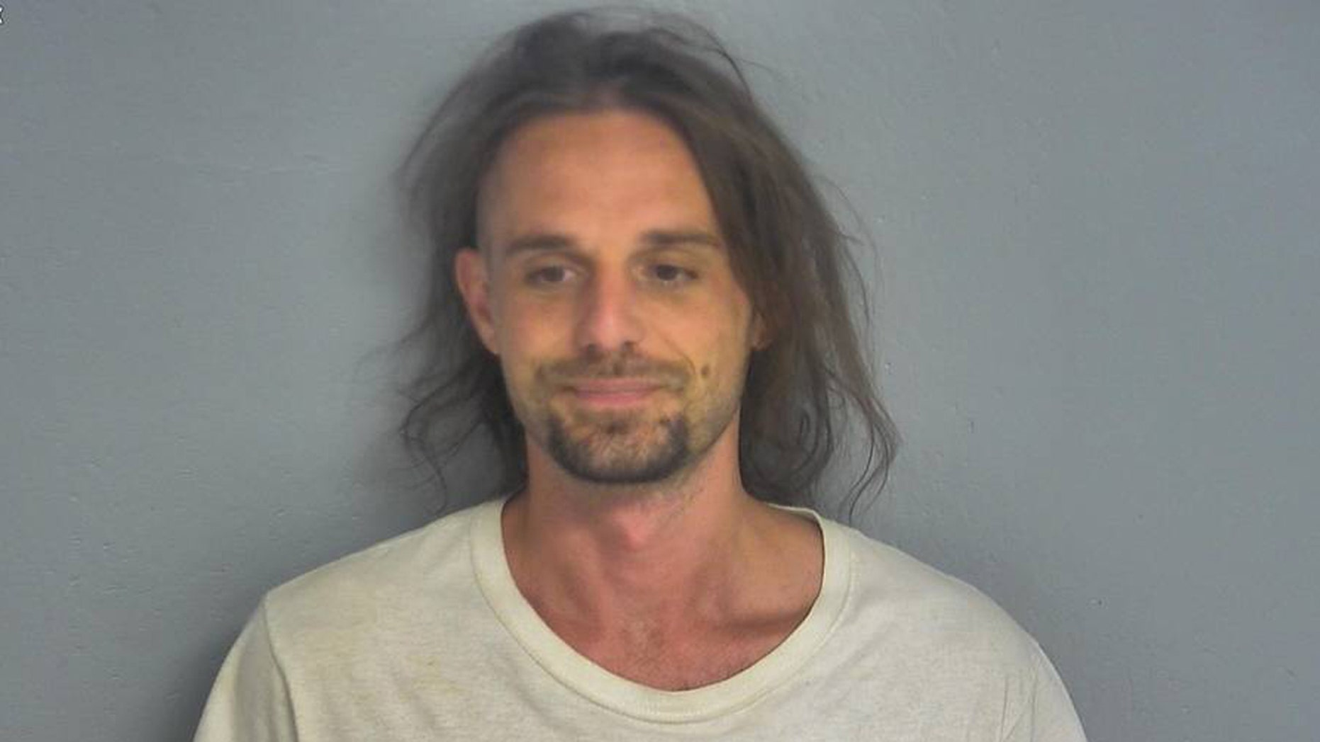 Dustin Burns, 33, is charged with a felony after recording a video of himself removing his ankle monitor, officials said.