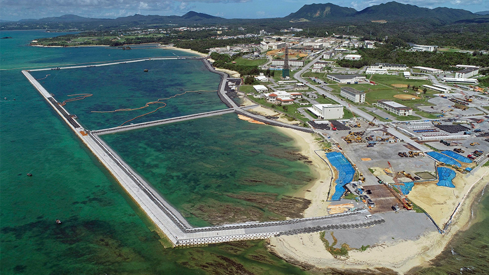 FILE - This Aug. 2018, file aerial photo shows preliminary construction work off Henoko, in Nago city, Okinawa prefecture, Japan, where the Japanese government plans to relocate a U.S. air base from one area of Okinawa's main island to another. Denny Tamaki, the newly elected governor of the southern Japanese island of Okinawa, was chosen in a Sept. 30 election, running on a campaign that rejected the U.S. base being built on coastal Henoko. He defeated, by a comfortable margin, the candidate backed by the ruling party, eager to go ahead with Henoko, whose construction has been on hold. (Koji Harada/Kyodo News via AP, File)