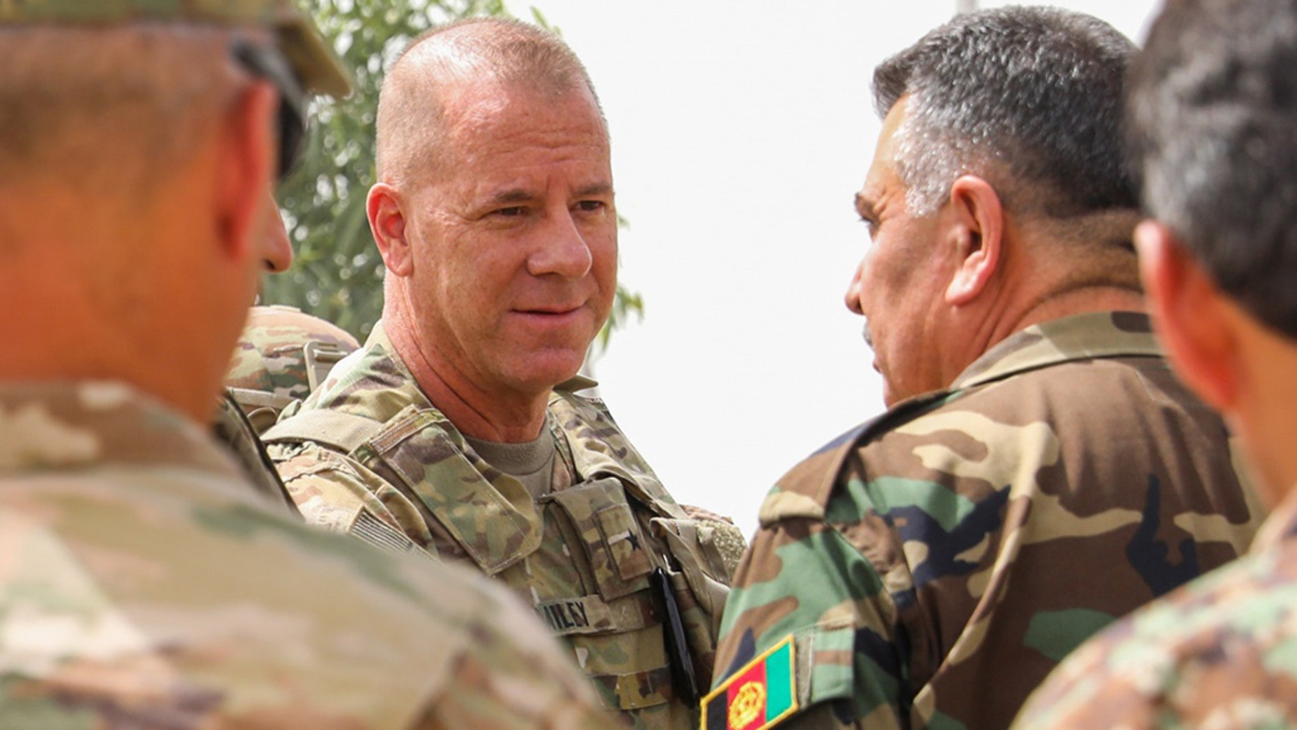 The Pentagon has confirmed that U.S. Army Brig. Gen. Jeffrey Smiley, center, was shot in a Taliban attack that killed two Afghan leaders in Kandahar province last week.