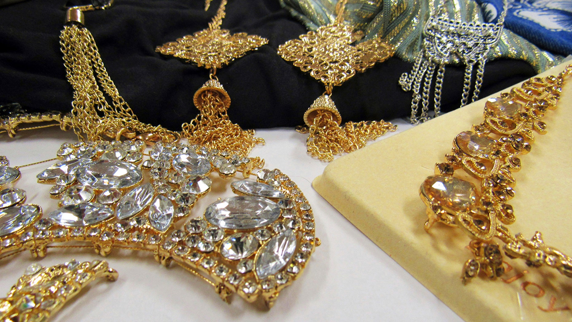 This Sept. 20, 2018 photo provided by the Center for Environmental Health (CEH) in Oakland, Calif., shows jewelry items loaded with the toxic metal cadmium they bought from the shelves of national retailers