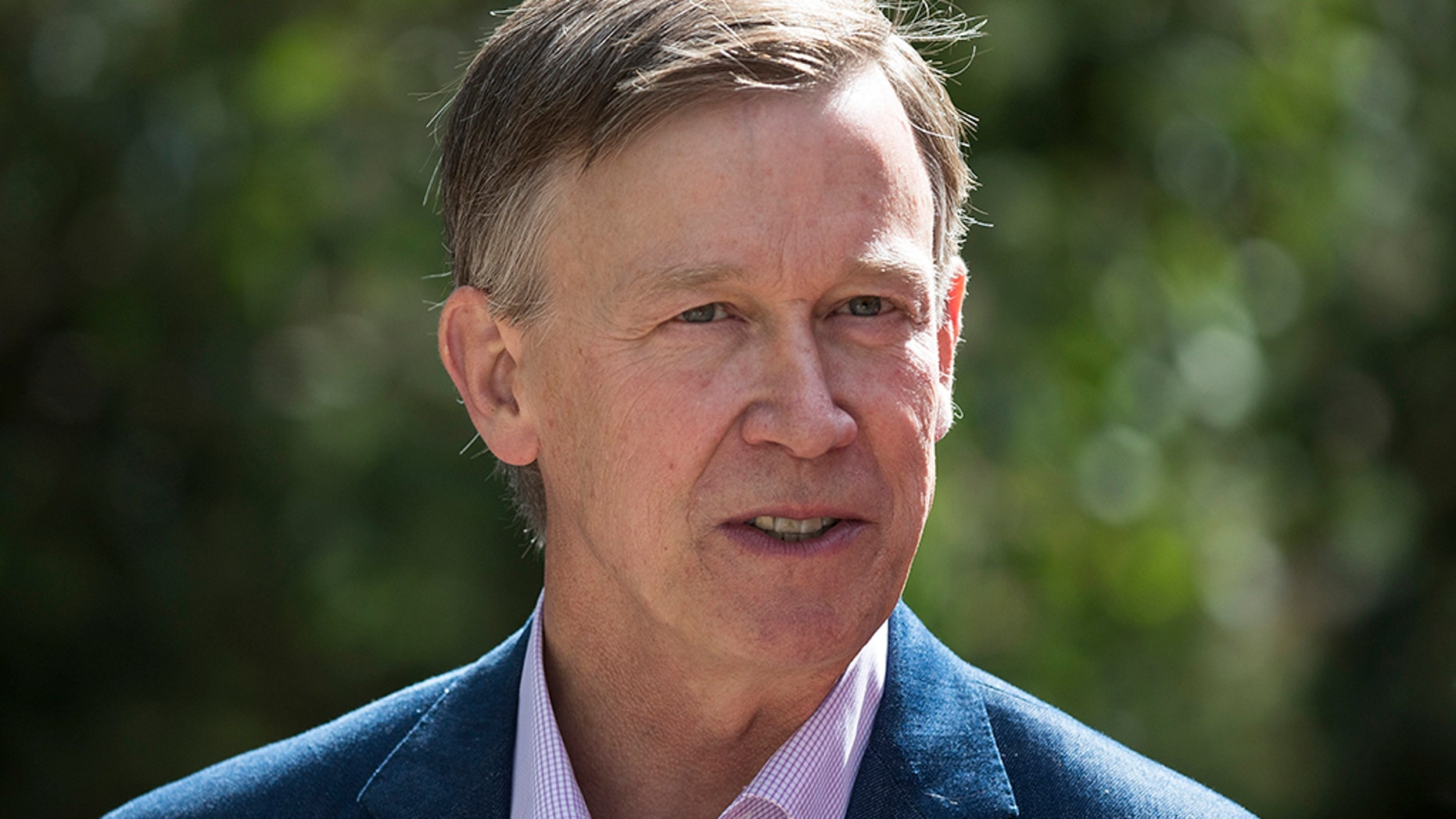 """Colorado Gov. John Hickenlooper, a Democrat, said he is """"leaning strongly"""" toward running for president."""
