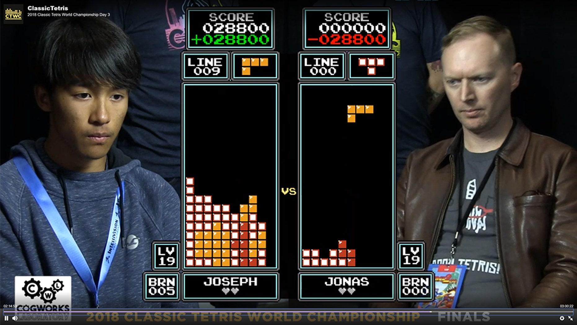 "Joseph Saelee (left) def. Jonas Neubauer (right) to win the Classic Tetris World Championship 201<div class=""e3lan e3lan-in-post1""><script async src=""//pagead2.googlesyndication.com/pagead/js/adsbygoogle.js""></script> <!-- Text_Display_Responsive --> <ins class=""adsbygoogle""      style=""display:block""      data-ad-client=""ca-pub-6192903739091894""      data-ad-slot=""3136787391""      data-ad-format=""auto""      data-full-width-responsive=""true""></ins> <script> (adsbygoogle = window.adsbygoogle || []).push({}); </script></div>8."