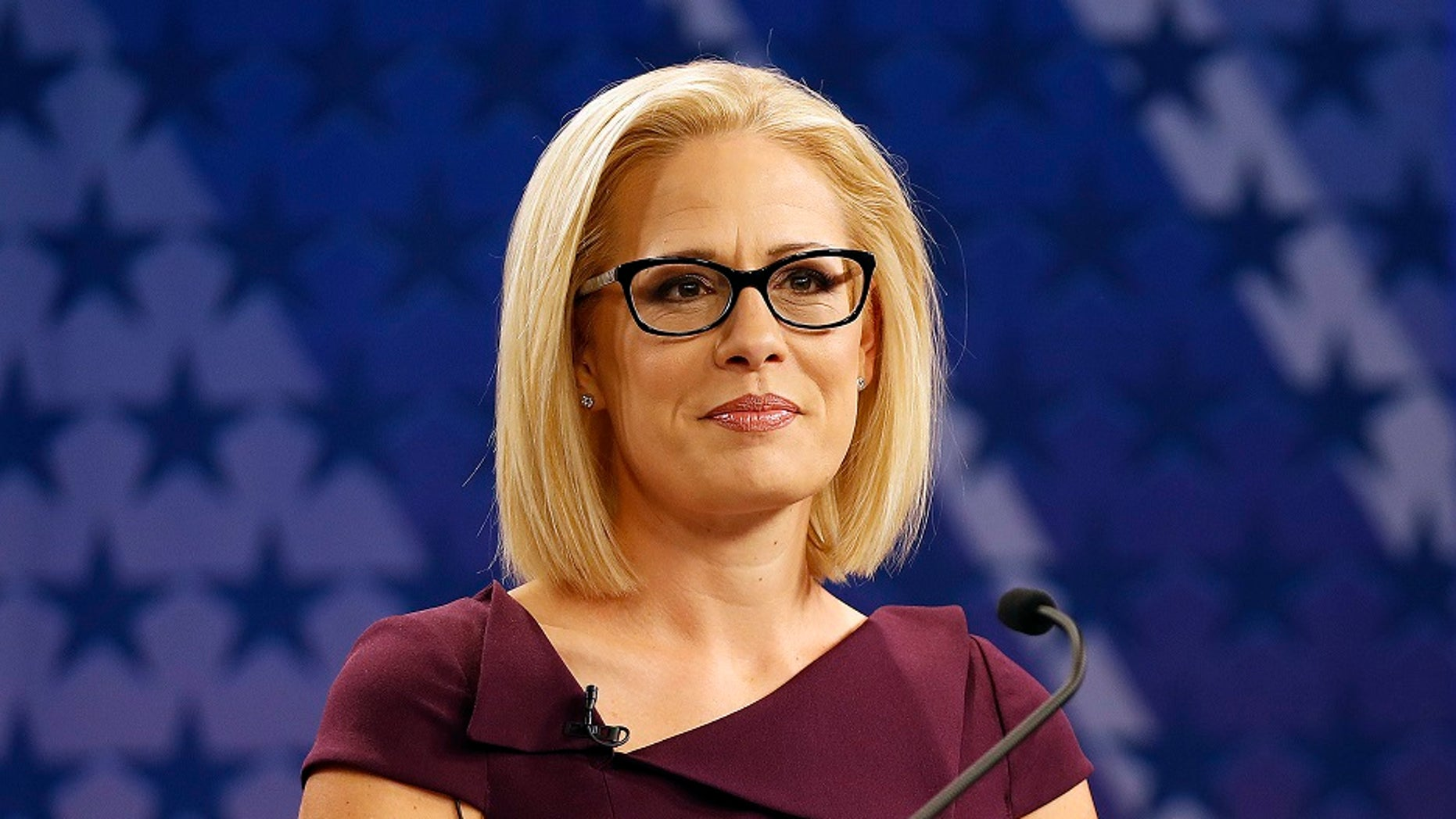U.S. Rep. Kyrsten Sinema, D-Ariz., goes over the rules in a television studio prior to a televised debate with U.S. Rep. Martha McSally, R-Ariz.