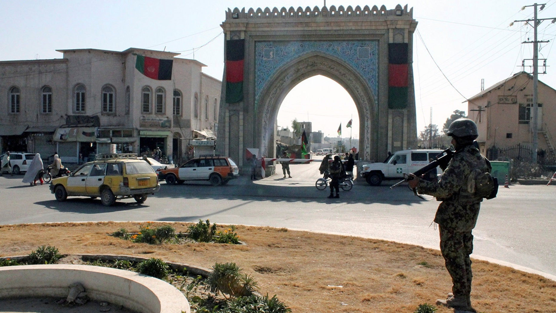 Two Americans were wounded in a shooting outside the governor's mansion in the southern Afghanistan province of Kandahar.