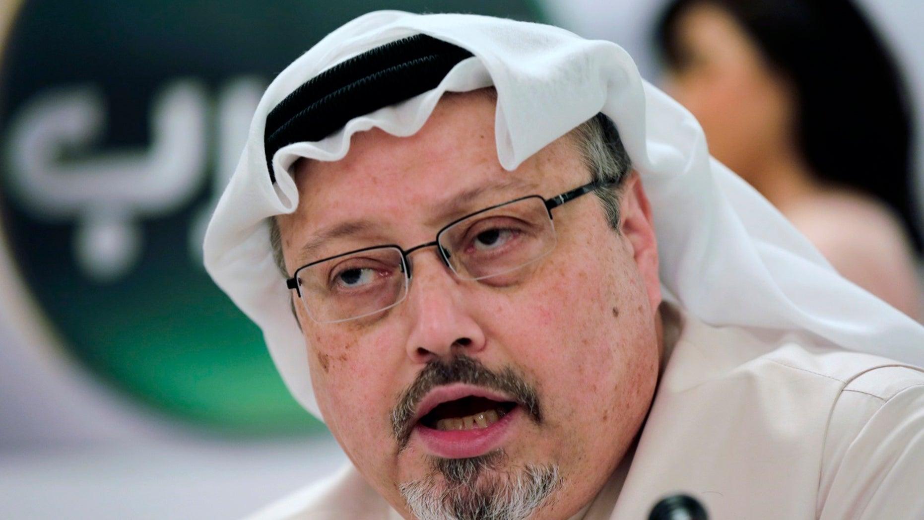 FILE - In this Feb. 1, 2015, file photo, Saudi journalist Jamal Khashoggi speaks during a press conference in Manama, Bahrain. (AP Photo/Hasan Jamali, File)