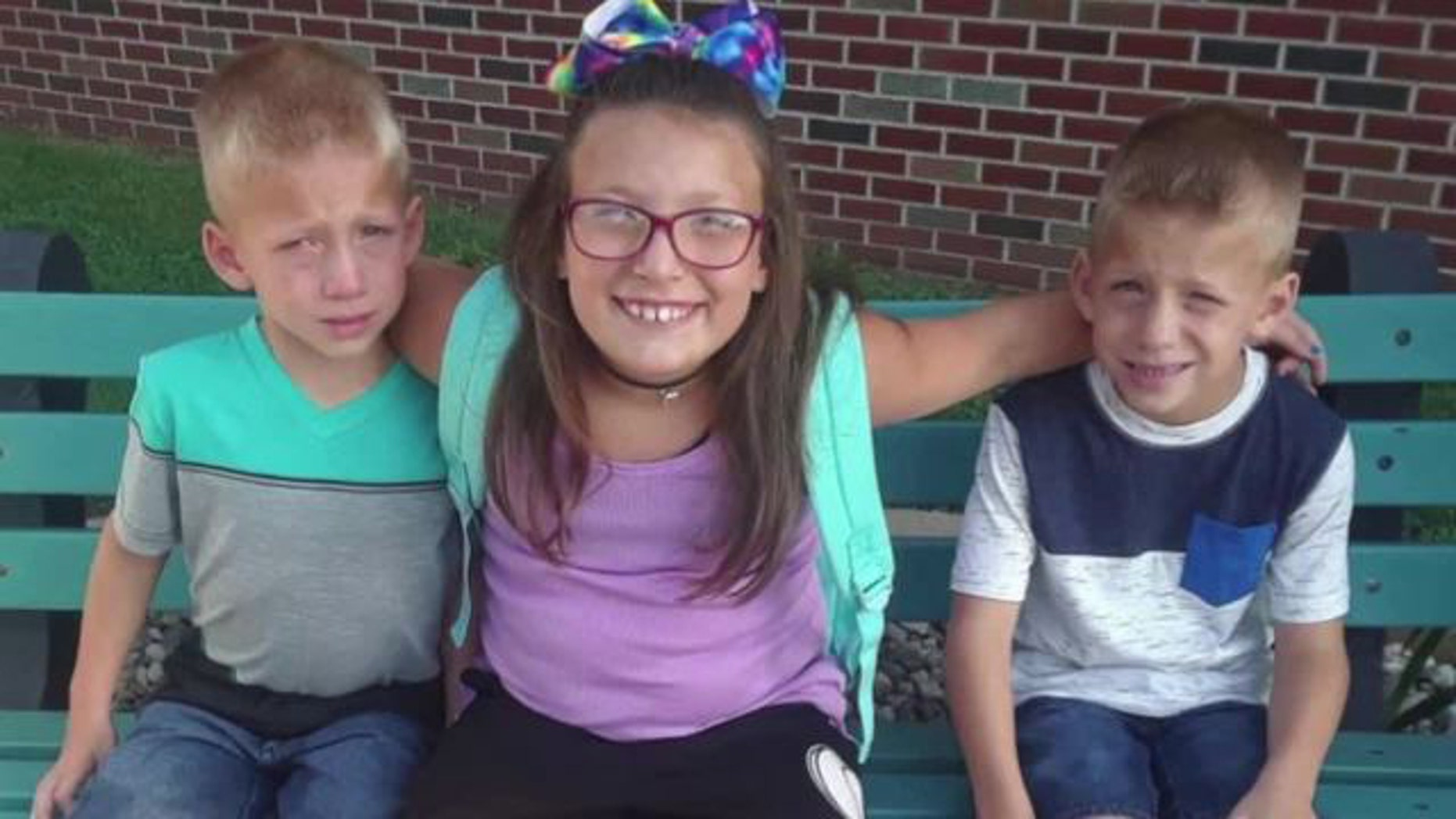Three young siblings were struck by a vehicle and killed at an Indiana school bus stop on Tuesday morning, police said.