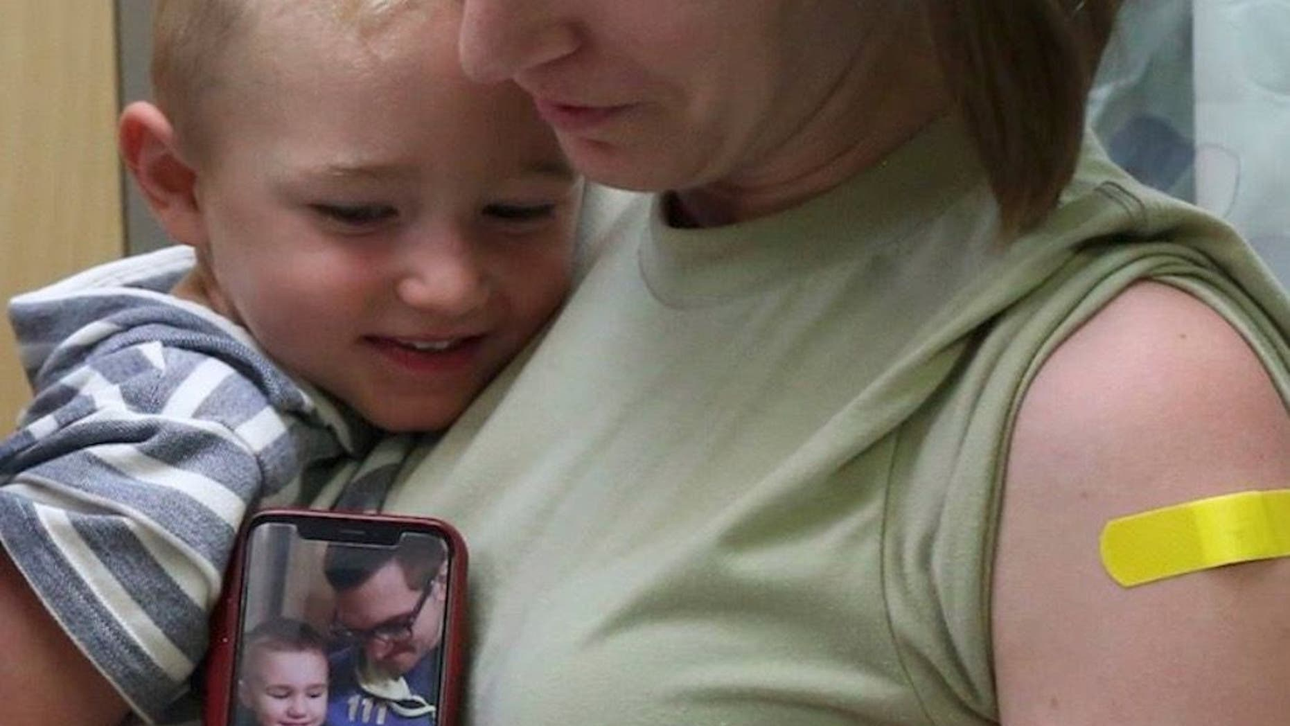 Laura Sidari, pictured holding one of her children and a photo of her husband with Leon, shortly after their second was born, is sharing the #FluShotsforLeon campaign after the boy died last year from complications of the virus.