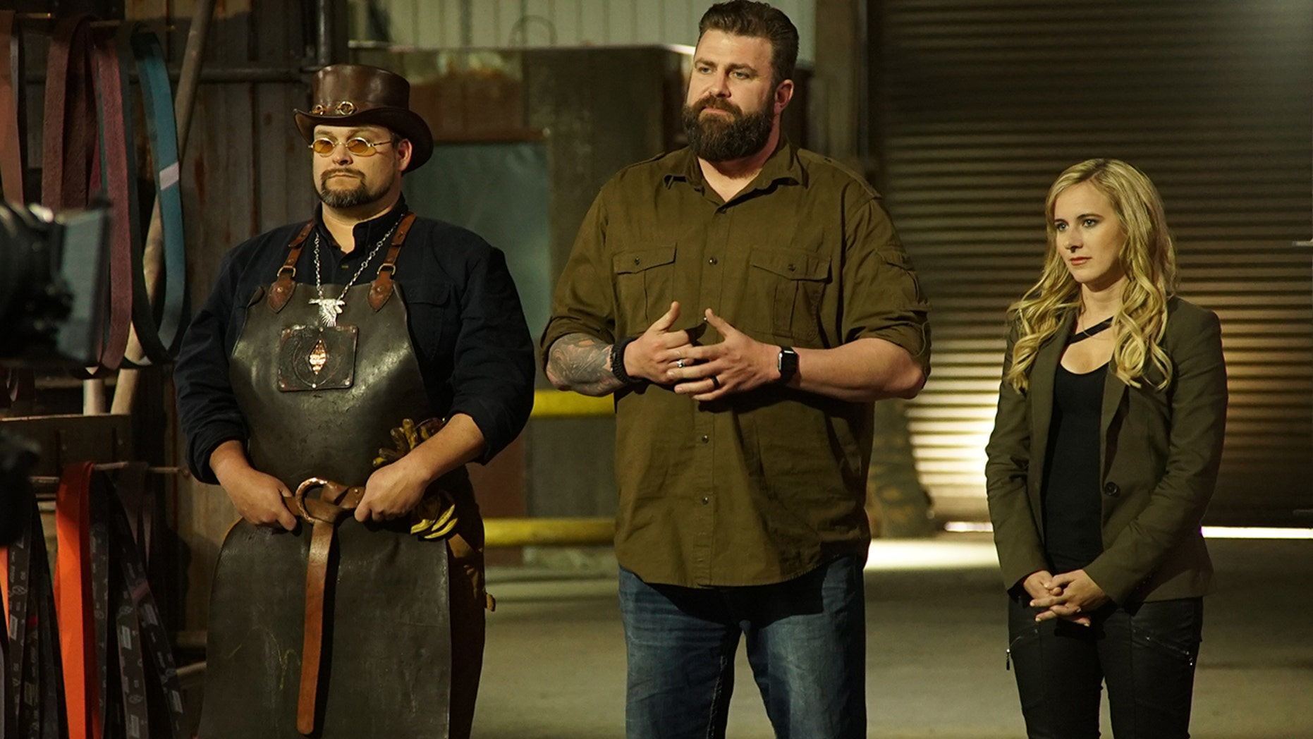 "Trent, Zeke and Ashley address contestants on Discovery's ""Master of Arms.'"