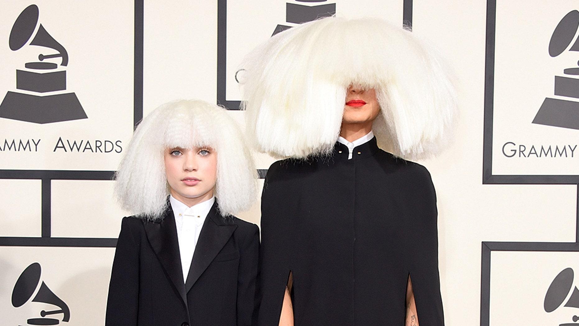 Pop star Sia (right) gave dancer Maddie Ziegler (left) an Audi for her birthday.