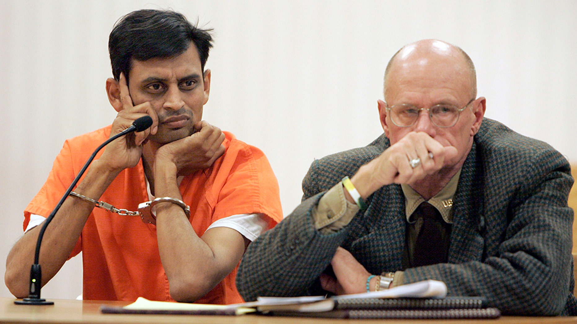 Manishkumar Patel, left, sits with his attorney during his initial court appearance at the Outagamie County Justice Center in Appleton, Wis., Nov. 29, 2007.