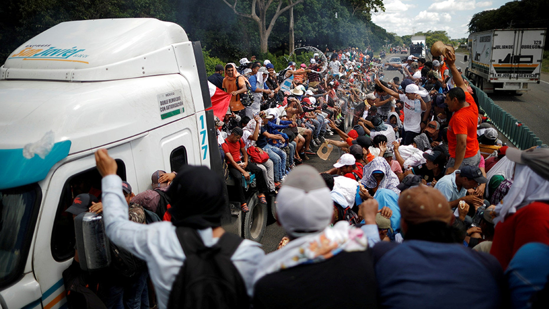 Central American migrants, who are part of a caravan of migrants trying to reach the United States, hitchhike on a truck along the highway as they continued their journey in Tapachula, Mexico, earlier this week.