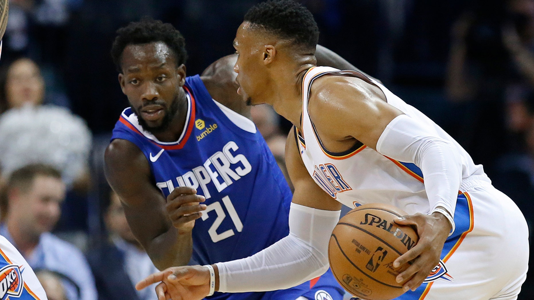 Oklahoma City Thunder guard Russell Westbrook, right, drives around Los Angeles Clippers guard Patrick Beverley (21) in the first half of an NBA basketball game in Oklahoma City, Tuesday, Oct. 30, 2018.