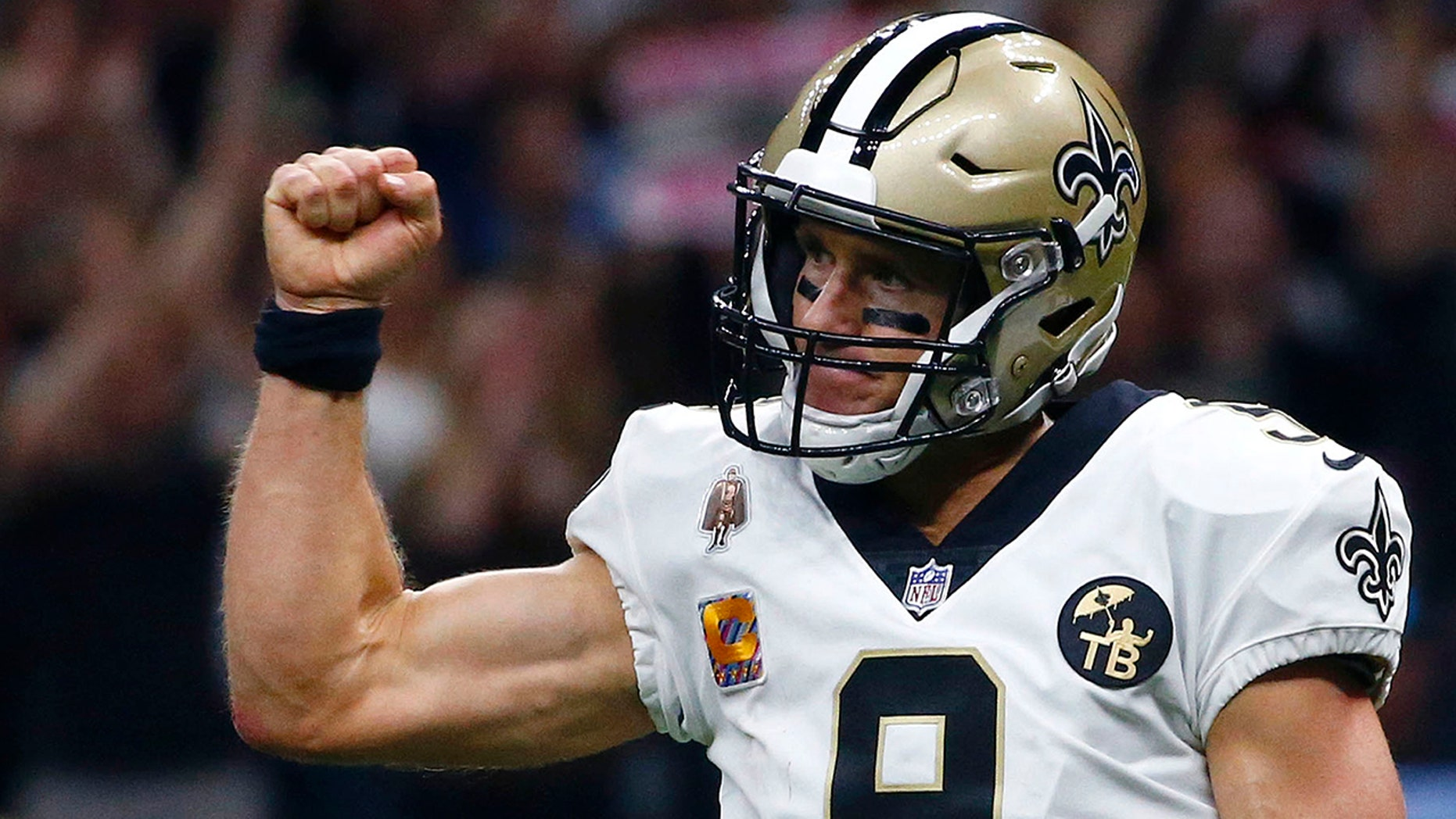 New Orleans Saints quarterback Drew Brees (9) reacts after throwing a touchdown pass in the first half of an NFL football game in New Orleans, Oct. 8, 2018.