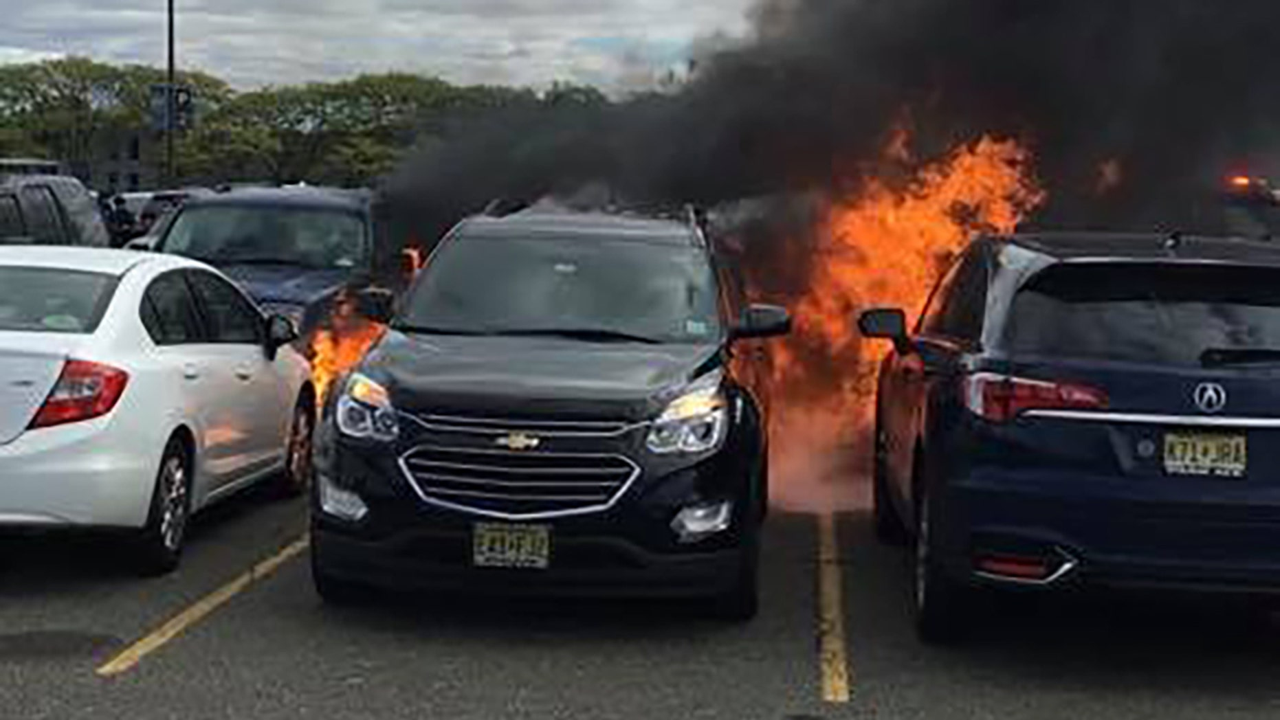 At least seven cars caught fire during the New York Jets game on Sunday.