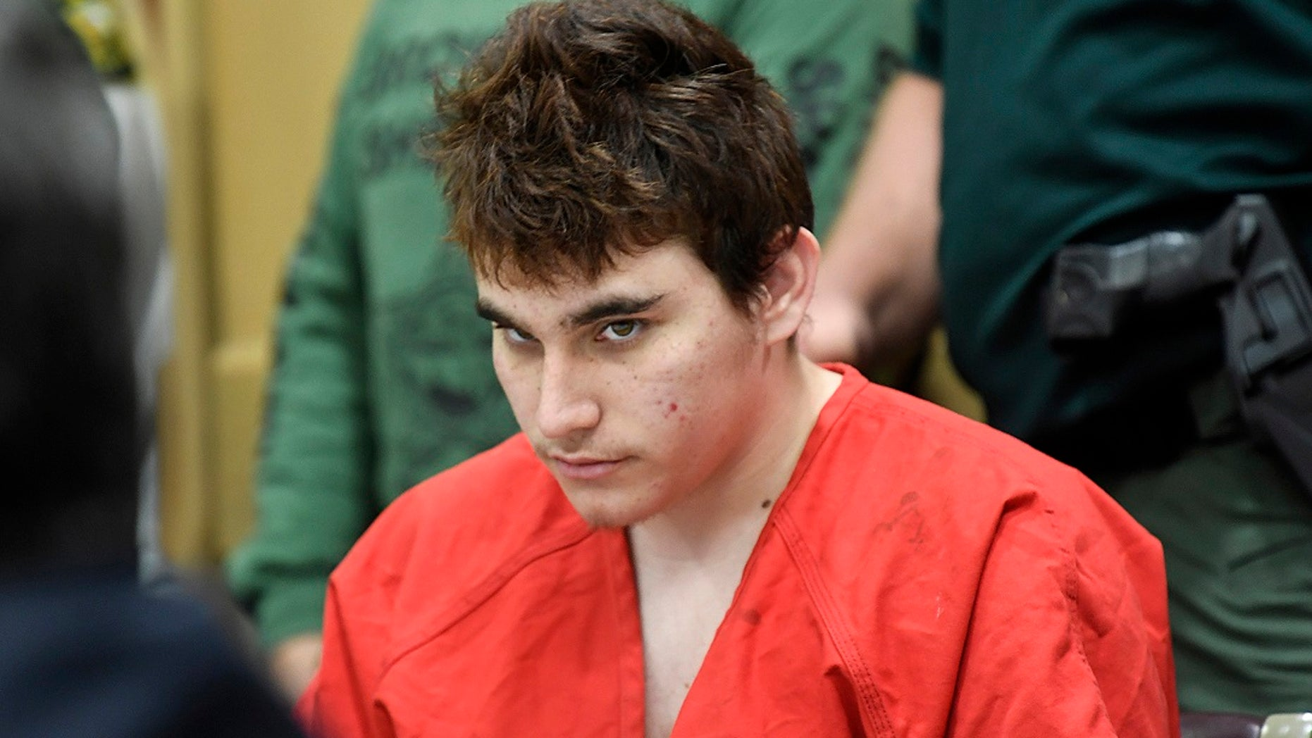 FILE - Florida school shooting suspect Nikolas Cruz looks up while in court for a hearing in Fort Lauderdale, Fla.