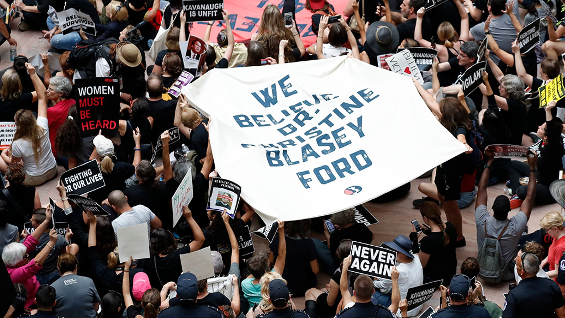 Protesters demonstrate on Capitol Hill against the nomination of Brett Kavanaugh to the Supreme Court.