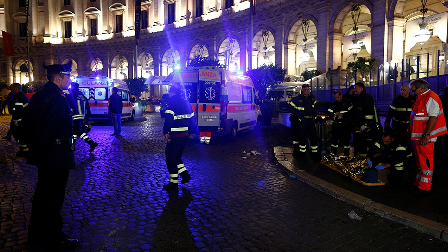 An injured person is seen outside the underground where some of CSKA Moscow supporters were injured in Rome, Italy, October 23, 2018.